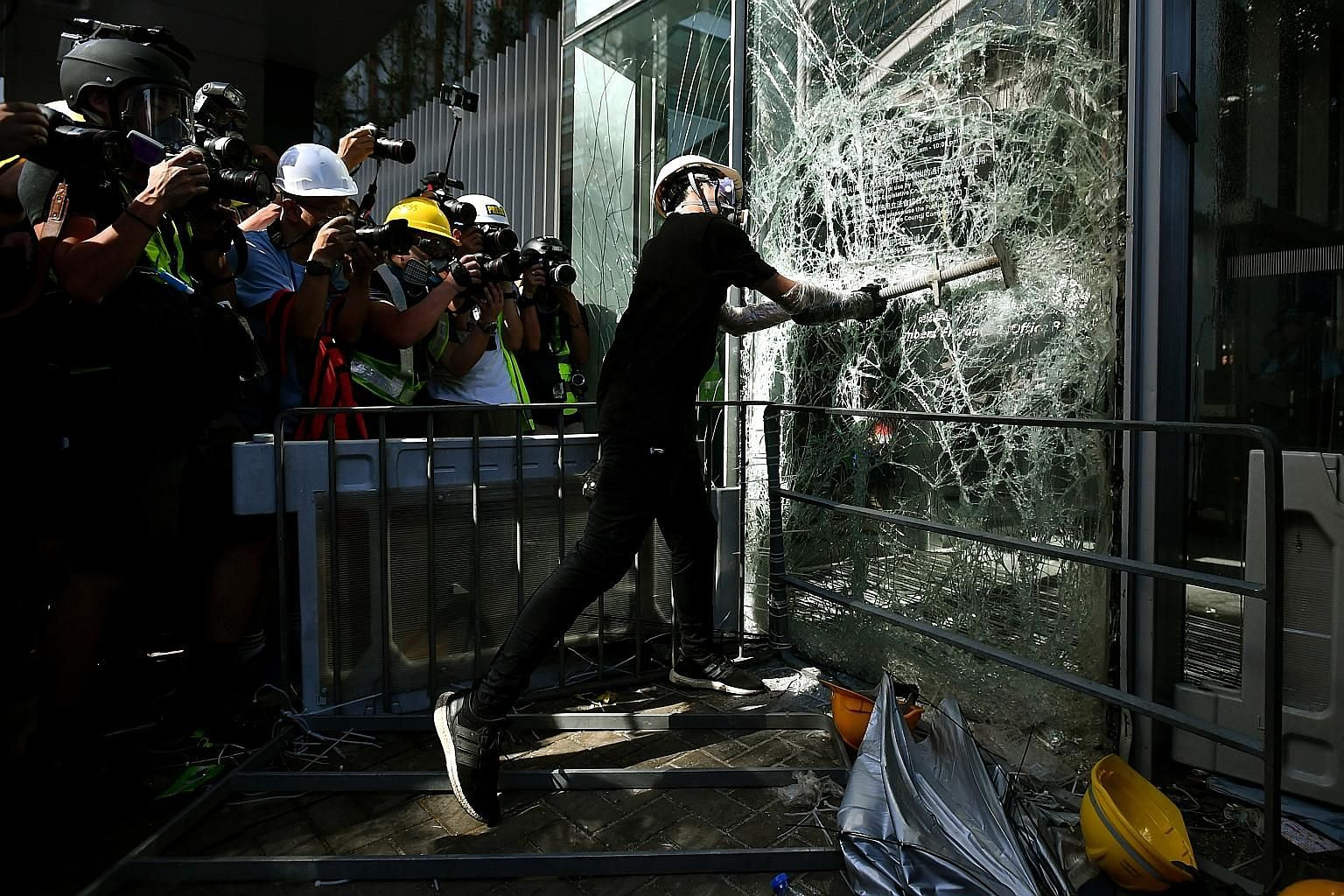 A protester smashing a glass panel at the Legislative Council building in Hong Kong on July 1, the anniversary of the city's handover to Chinese rule. This photo will be among the highlights at the Through The Lens exhibition at the National Museum o
