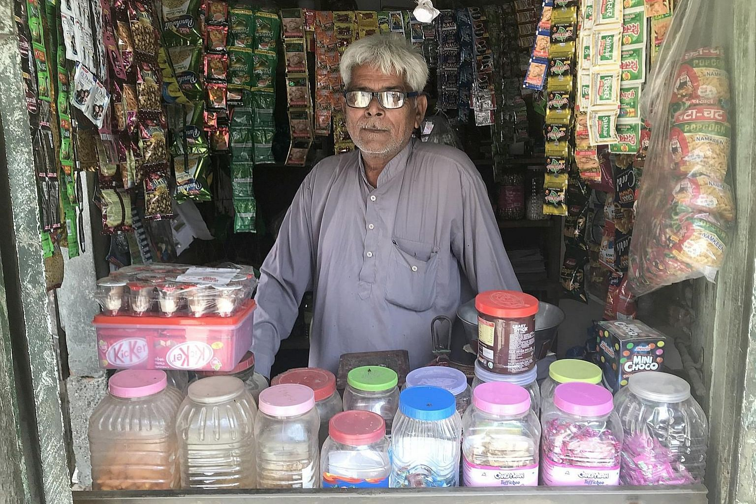 Above: Shopkeeper Moolchand said that over the past two years, his average daily sales have dropped by half. Left: Mr Manu Raghuvanshi, who sells tractors, has seen his sales fall by 25 per cent from last year.