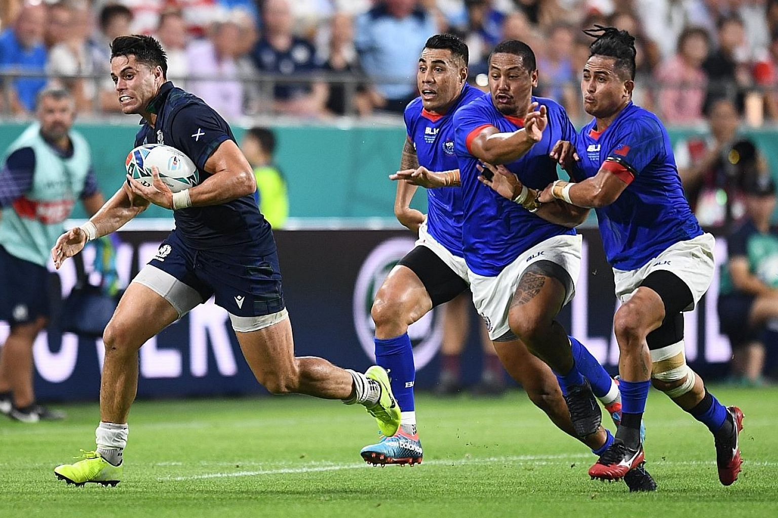Scotland's Sean Maitland outpacing the Samoan team to score their first try, setting the Scots on the way to a 34-0 whitewash and a fighting chance for second spot in their pool: