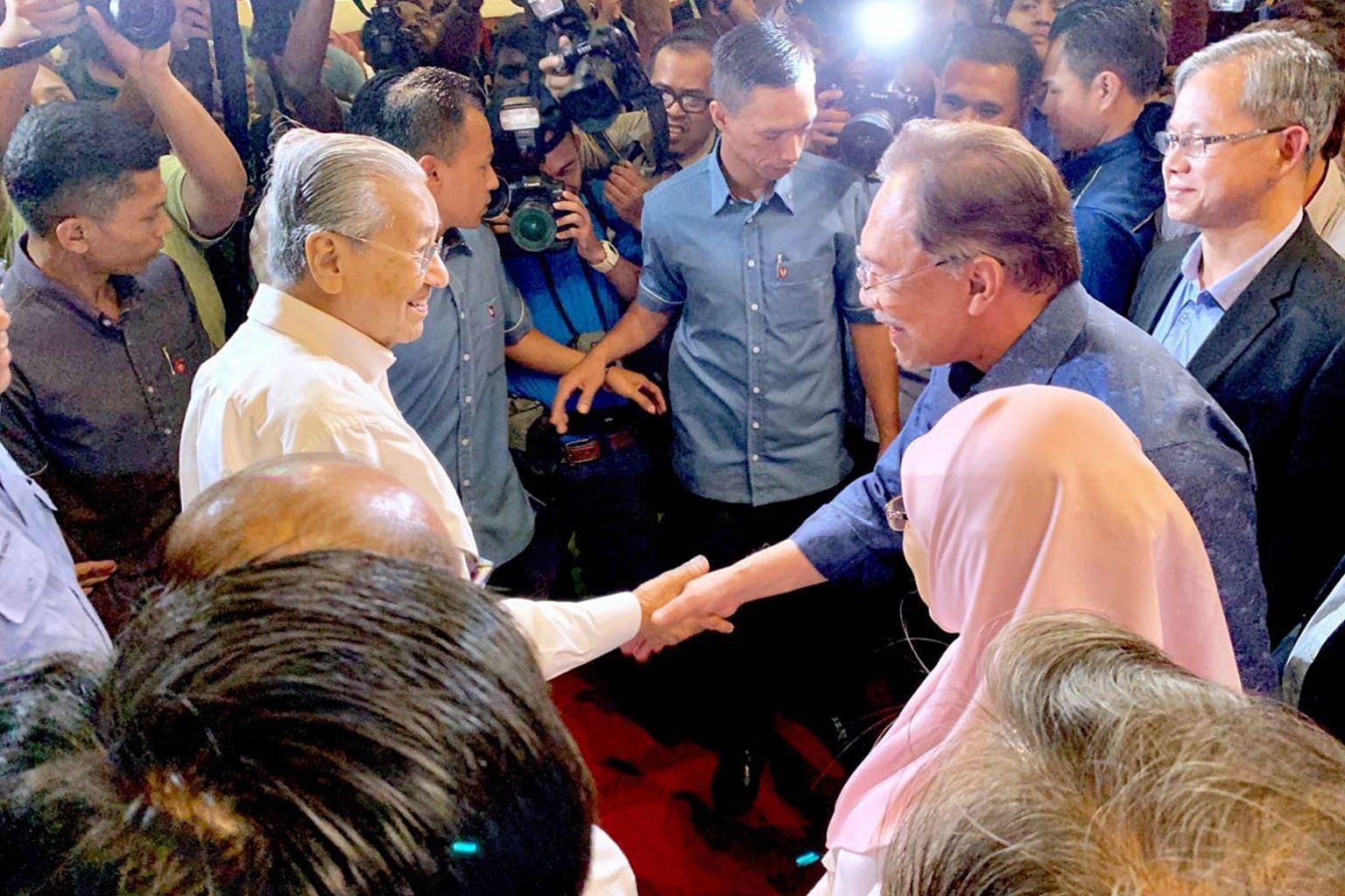 Malaysian Prime Minister Mahathir Mohamad (left) being greeted by Parti Keadilan Rakyat president Anwar Ibrahim in Port Dickson on July 19. In a recent interview, Mr Anwar's assertion that he expected to take over the top job around May next year sen