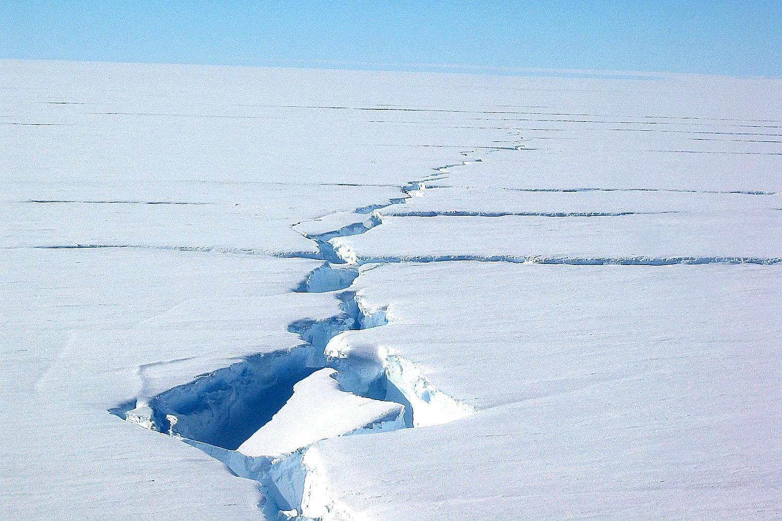 "A picture courtesy of the Australian Antarctic Division showing a ""loose tooth"" on the Amery Ice Shelf in eastern Antarctica. The 1,636-sq km table iceberg, officially called D-28, separated from the front of the ice shelf on Sept 26. Scientists do n"