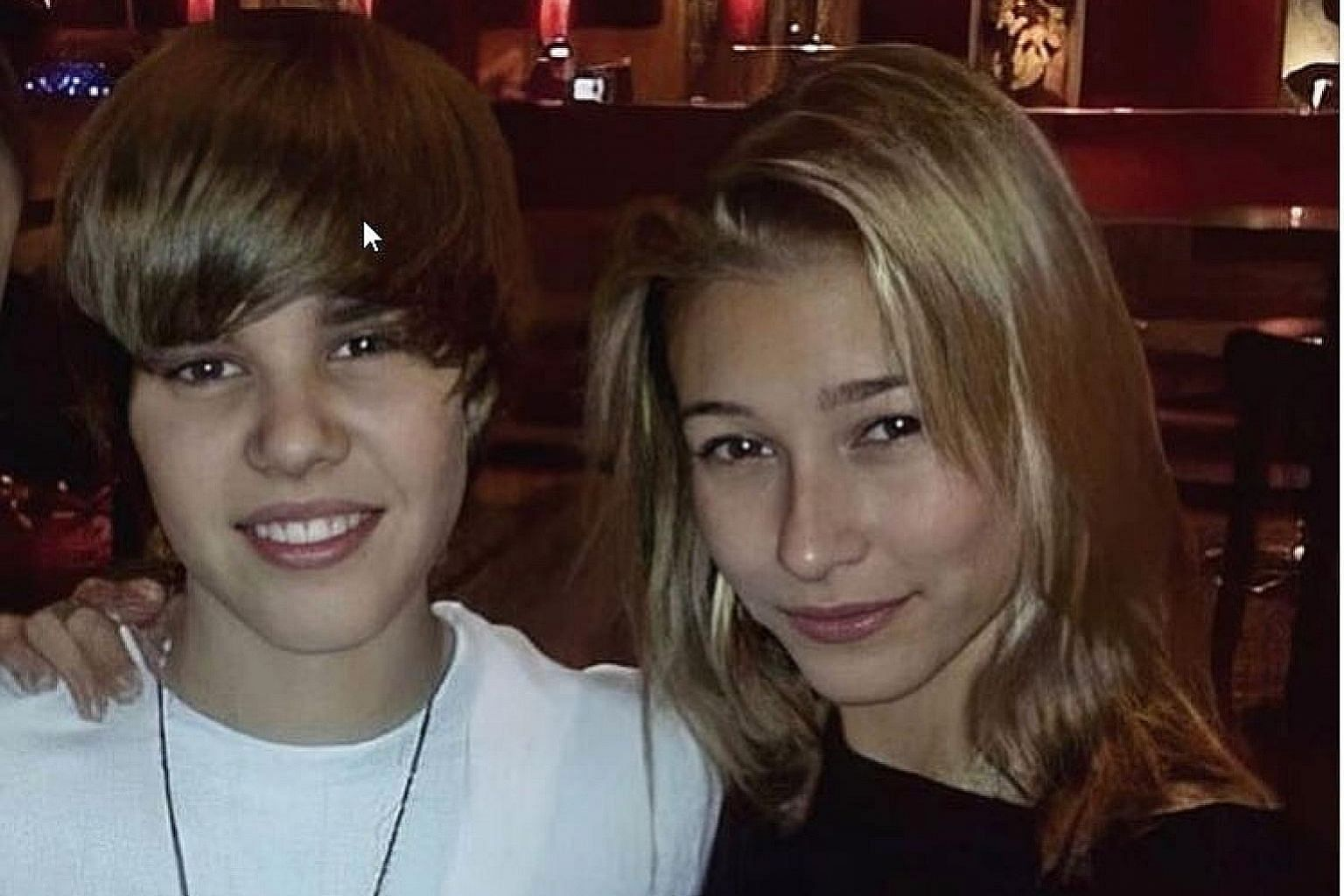"""BLAST FROM THE PAST: Justin Bieber and Hailey Baldwin first said """"I do"""" on Sept 13 last year in a spartan New York courthouse. On Monday evening, they married again, this time before 154 guests in a swanky waterfront resort in South Carolina. While i"""