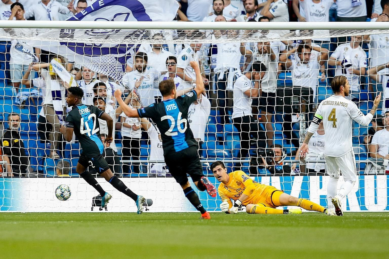 Brugge forward Emmanuel Bonaventure (left) reeling away after scoring the first goal in the Champions League Group A match against Real Madrid at the Santiago Bernabeu on Tuesday. Real recovered to clinch a 2-2 draw.