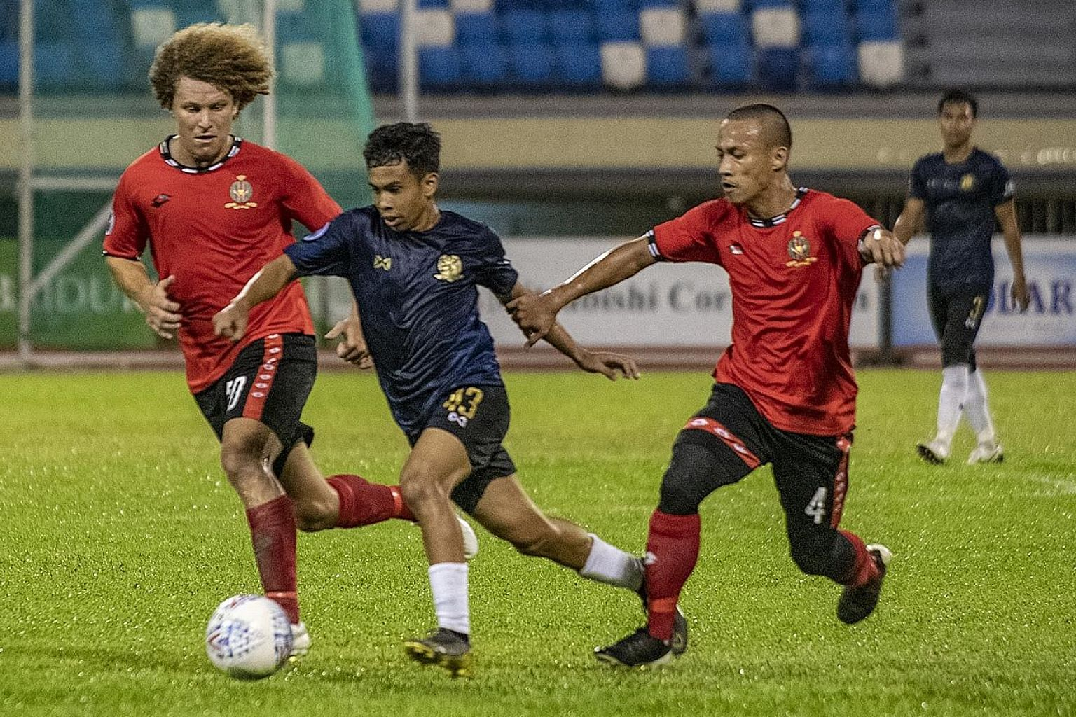 Hougang United's 16-year-old winger Farhan Zulkifli (centre), a first-year electrical engineering student at ITE College West, has 10 senior club starts since his Singapore Premier League debut in June.