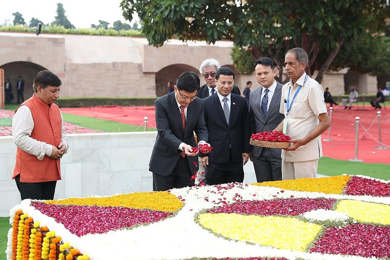 Deputy Prime Minister Heng Swee Keat paying tribute to Mahatma Gandhi at Raj Ghat, Delhi, on Gandhi's 150th birth anniversary. Beside him are Mr Desmond Lee, Minister for Social and Family Development and Second Minister for National Development, and