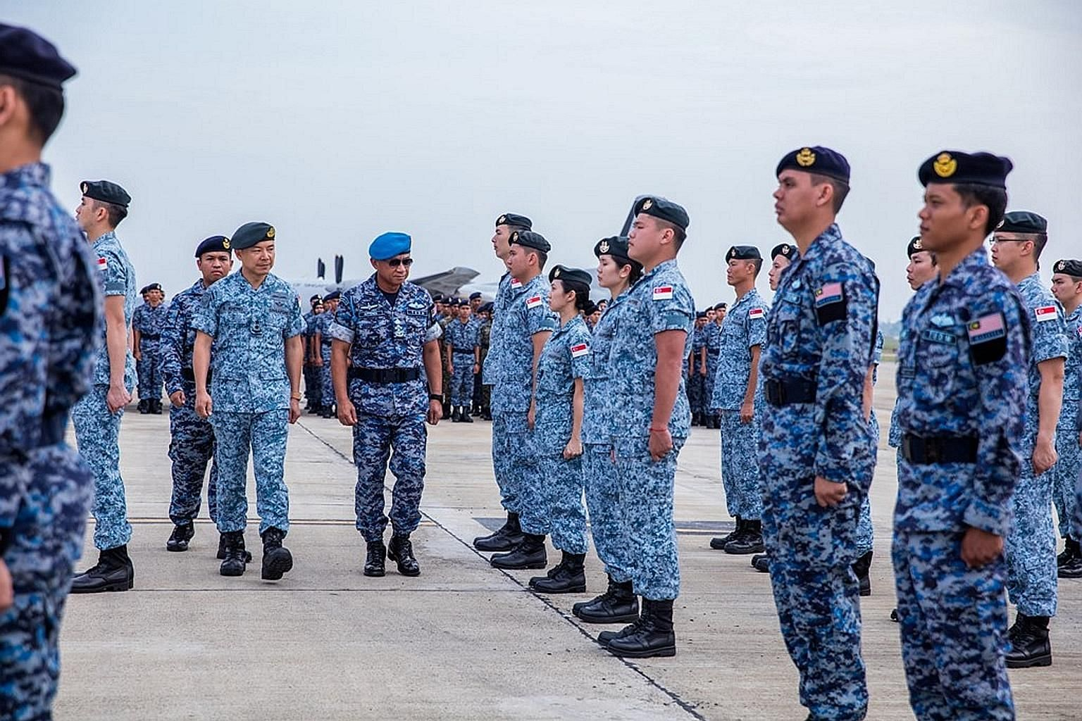 Singapore's Chief of Air Force Kelvin Khong and Royal Malaysian Air Force Chief Affendi Buang co-officiating the opening ceremony of Sarex Malsing at Kuantan Air Base yesterday. Participants in the exercise plan and execute joint aerial search and me