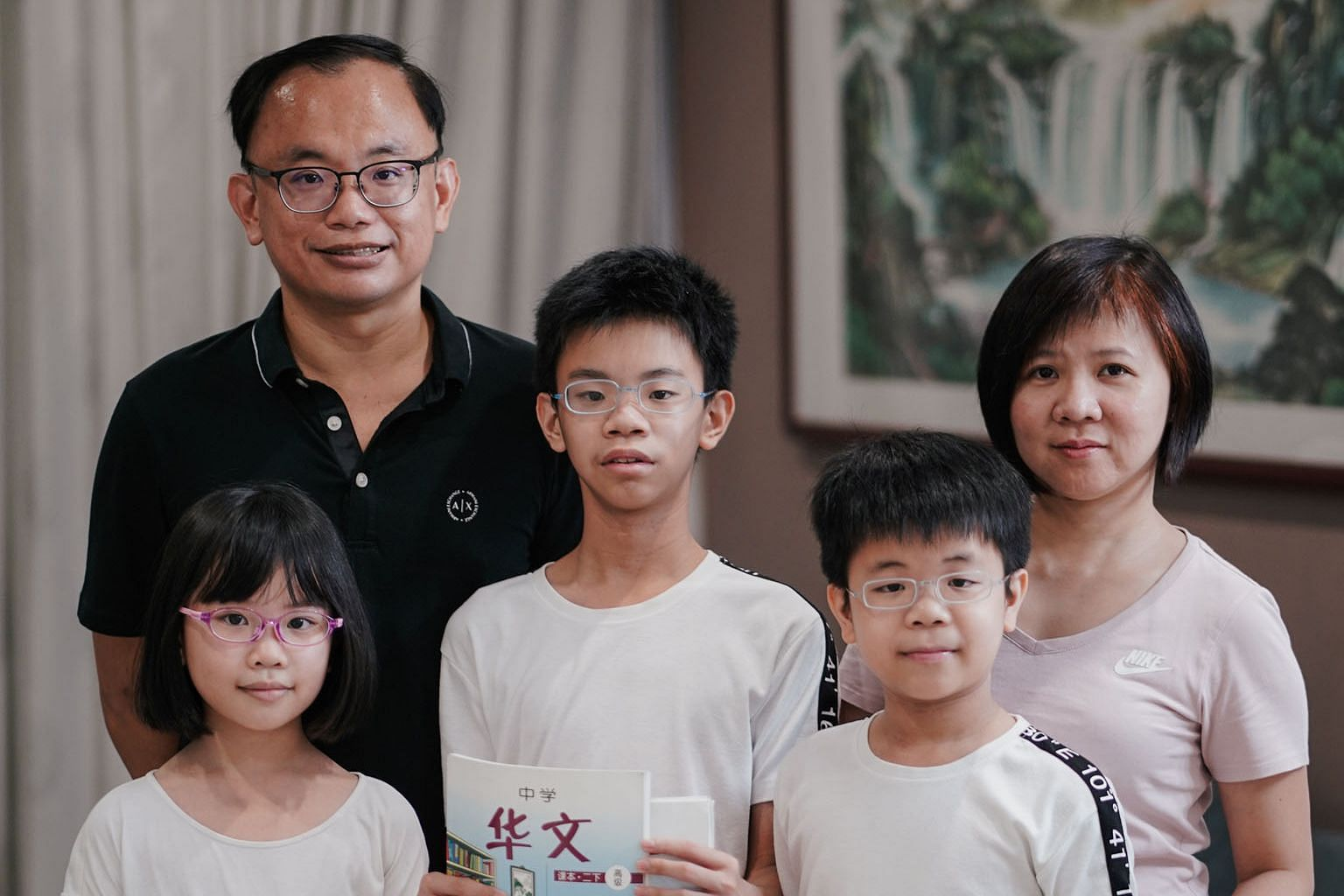 Mr Lim Wee Ming, 44, with his wife, Ms Koh Shin Nuo, 41, and their children (from far left) Nerelle, nine, Xavier, 14, and Iden, 11. Both Xavier and Iden are taking Higher Chinese in school.