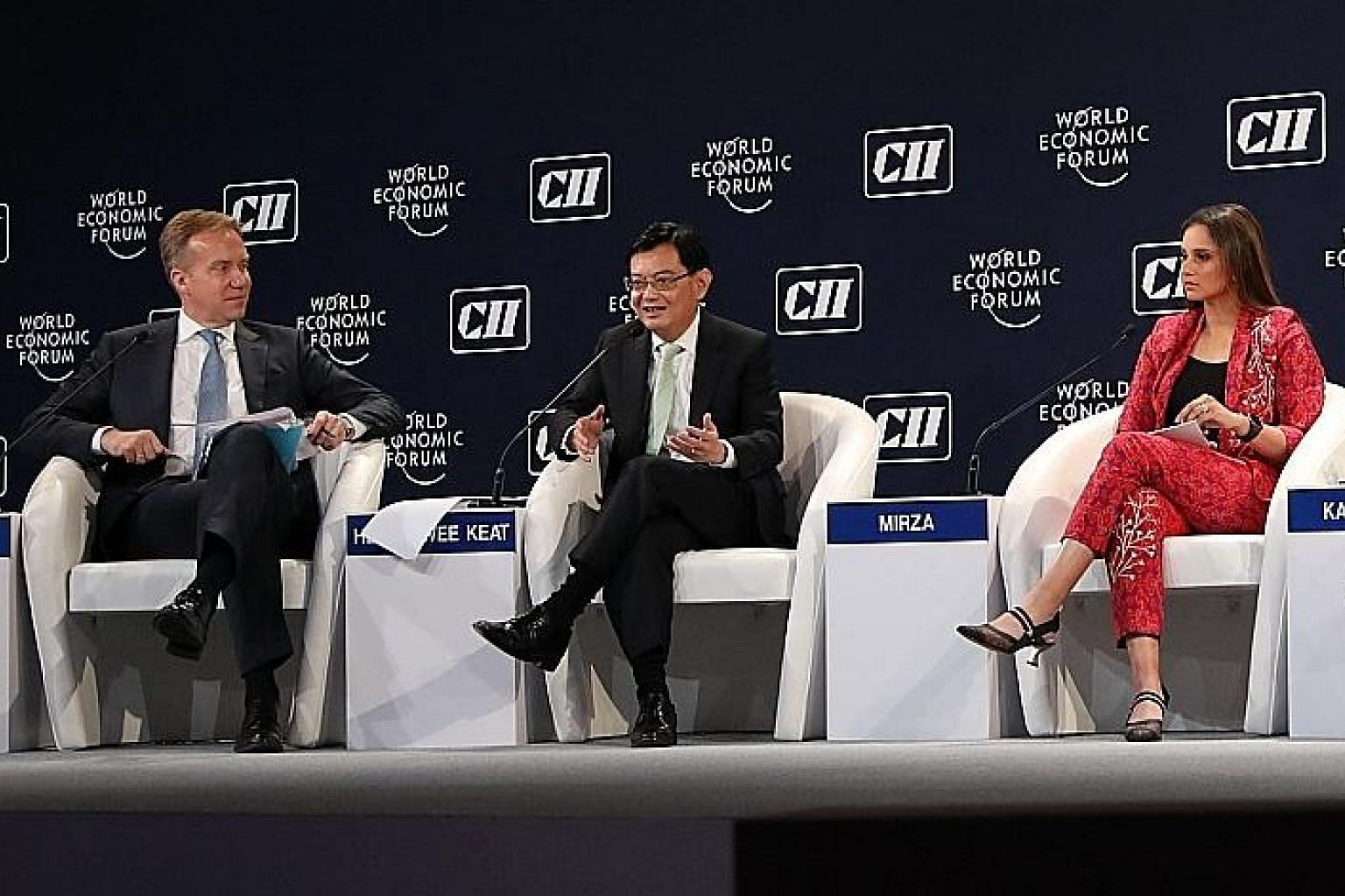 (From left) World Economic Forum president Borge Brende, Deputy Prime Minister Heng Swee Keat and United Nations Women Goodwill Ambassador for South Asia Sania Mirza at the India Economic Summit in New Delhi. PHOTO: MFA