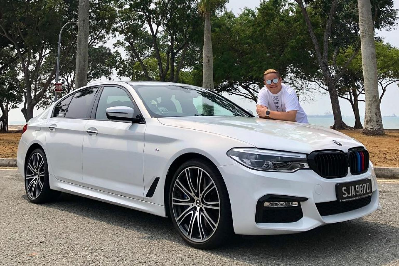 Justin Ang had the BMW 540i wrapped in white, which is reversible, as opposed to having it resprayed.