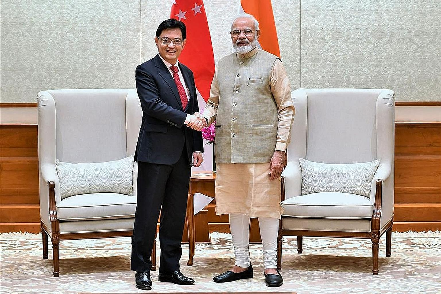 Deputy Prime Minister Heng Swee Keat meeting Indian PM Narendra Modi (left) and Bangladesh PM Sheikh Hasina in New Delhi yesterday. PHOTOS: PRESS INFORMATION BUREAU, GOVERNMENT OF INDIA; MINISTRY OF COMMUNICATIONS AND INFORMATION