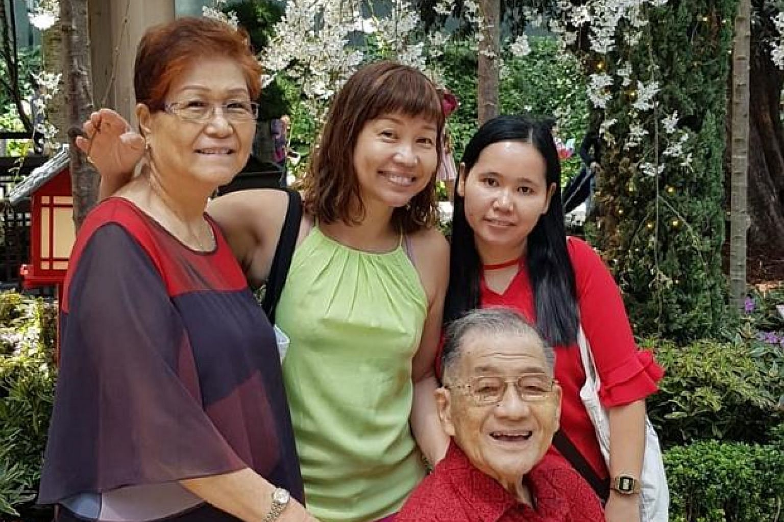 Invest editor Lorna Tan (in green top) with her parents Ann Lee and Allan Tan, and helper Halimah during a family outing to the Flower Dome at Gardens by the Bay.