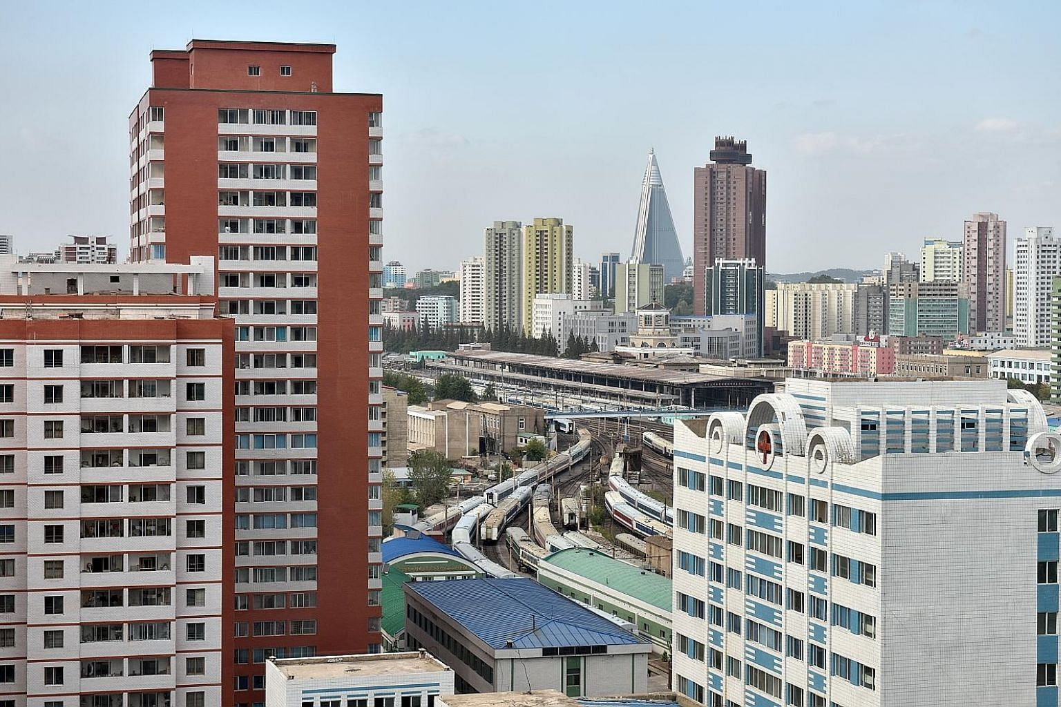 Residents living on the top floors of some high-rise apartment buildings in central Pyongyang overlook government buildings where North Korean leader Kim Jong Un and other party elites work, a news report said.