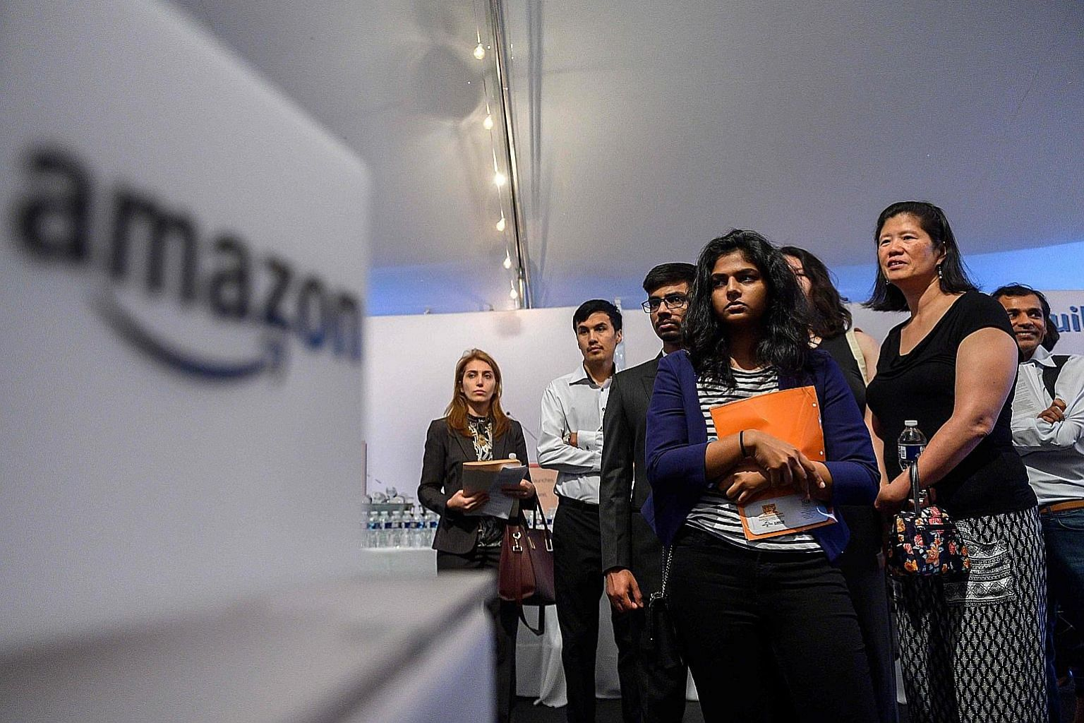 Job hunters at an Amazon Career Day event in the US. A report on Friday showed job growth slowed down last month and wage growth stalled, even as unemployment dropped to a 50-year low. Surveys released earlier last week showed factory activity is con