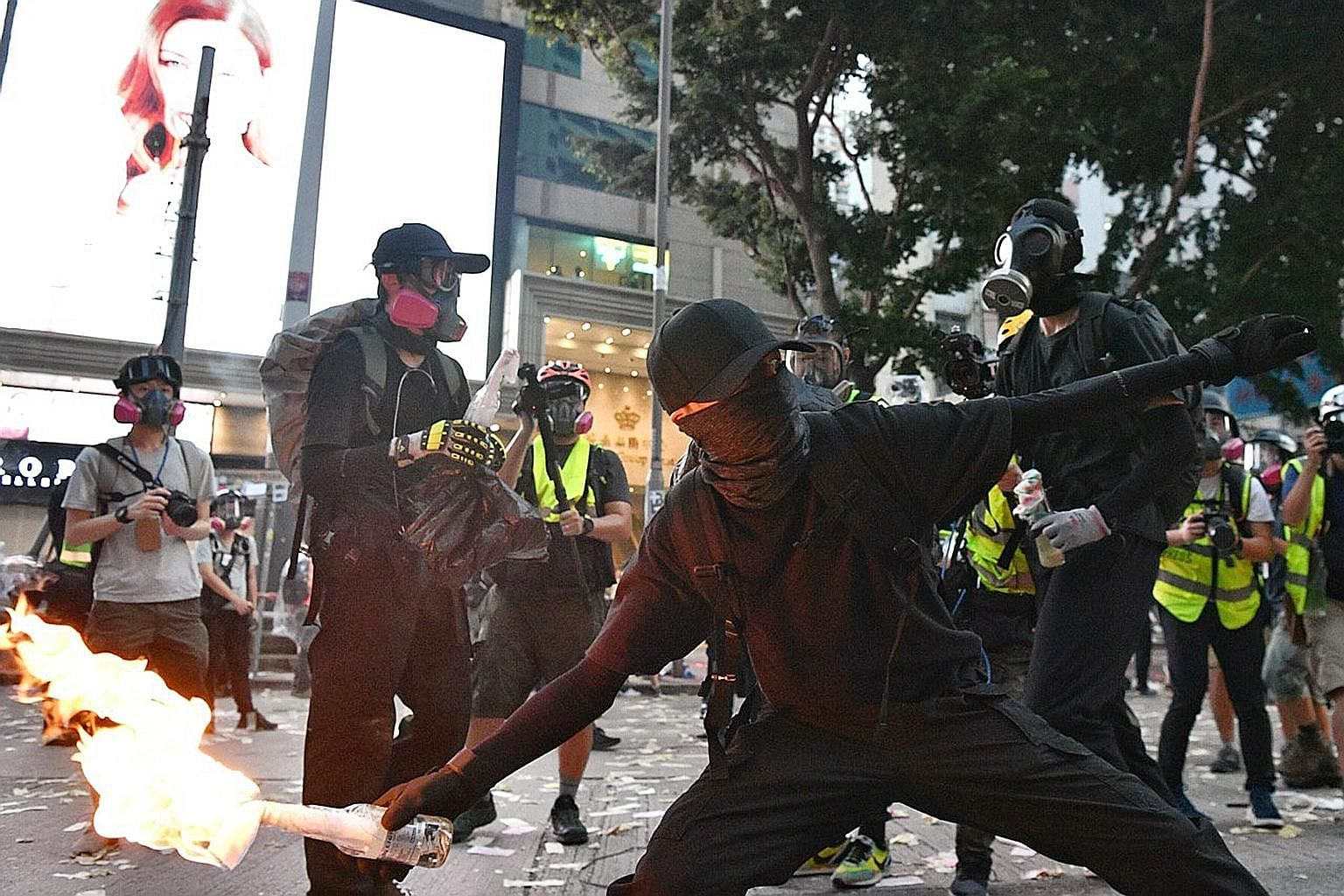 """Hong Kong protesters throwing petrol bombs at the police last Tuesday. The current cycle of protests is heir to the """"Occupy Movement"""" of 2014 when Hong Kong people rallied against Beijing's attempts to curtail democratic freedoms protected under the"""