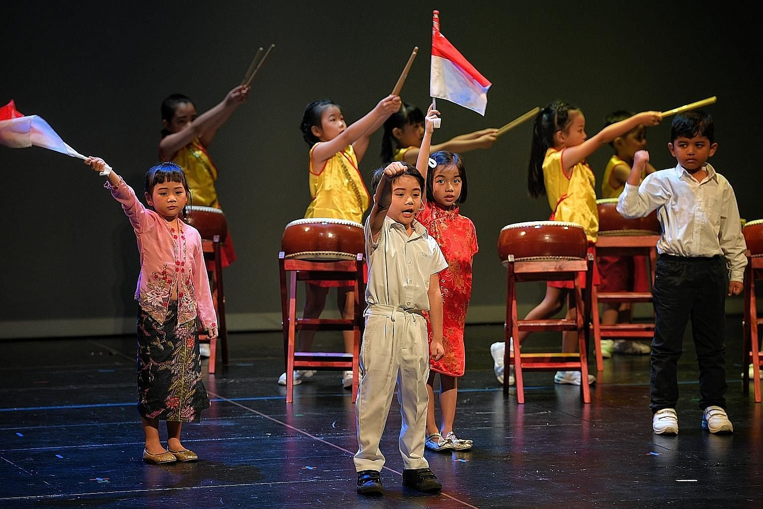 Children from PCF Sparkletots performing during the annual Family Day event held at the Victoria Theatre yesterday. ST PHOTO: MARK CHEONG