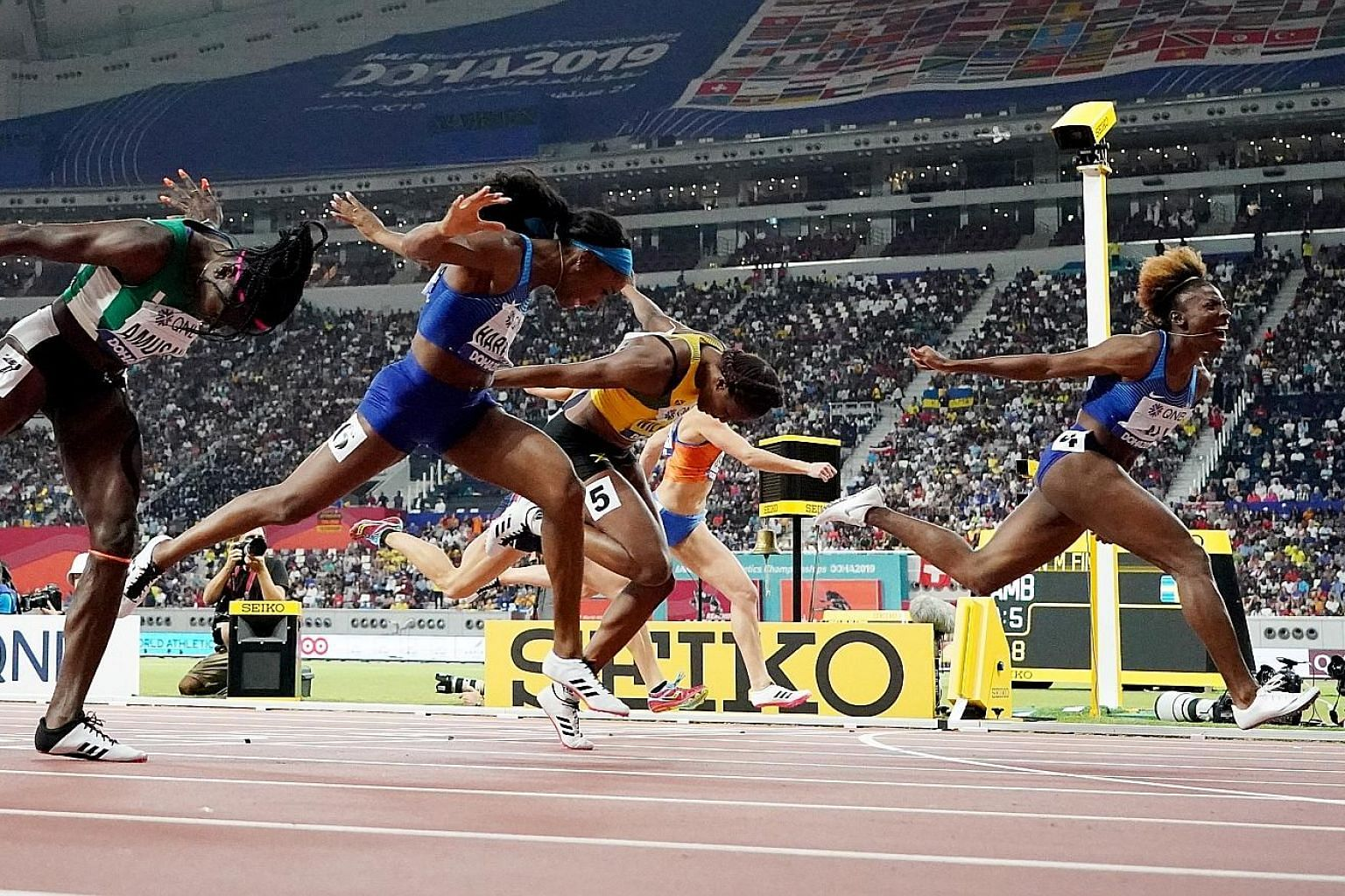 Nia Ali beating fellow American Kendra Harrison to the gold in the 100m hurdles at the World Athletics Championships in Doha, with Jamaica's Danielle Williams taking the bronze.