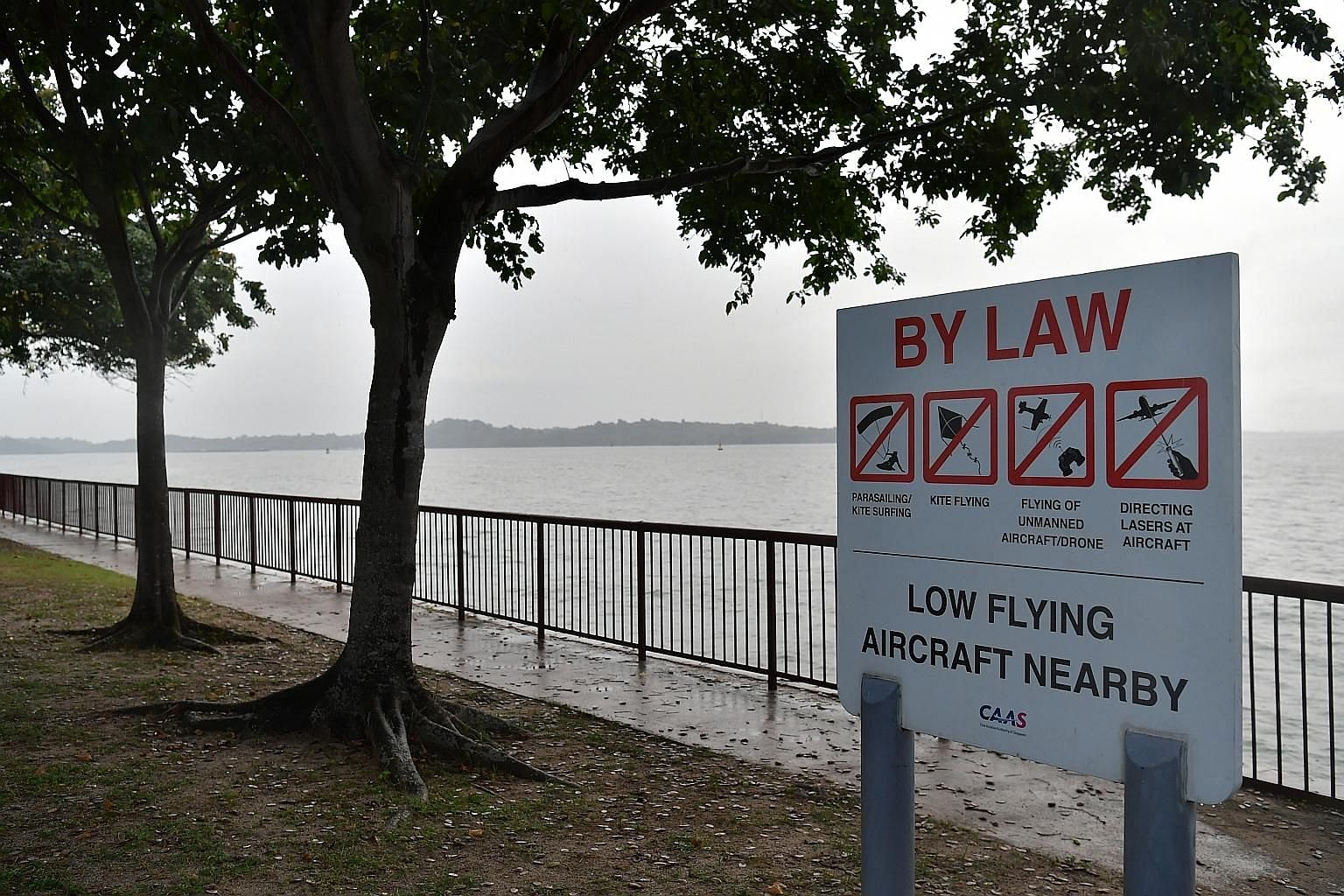A sign at Changi Beach warning against the flying of drones and other activities that could affect flights at nearby Changi Airport.