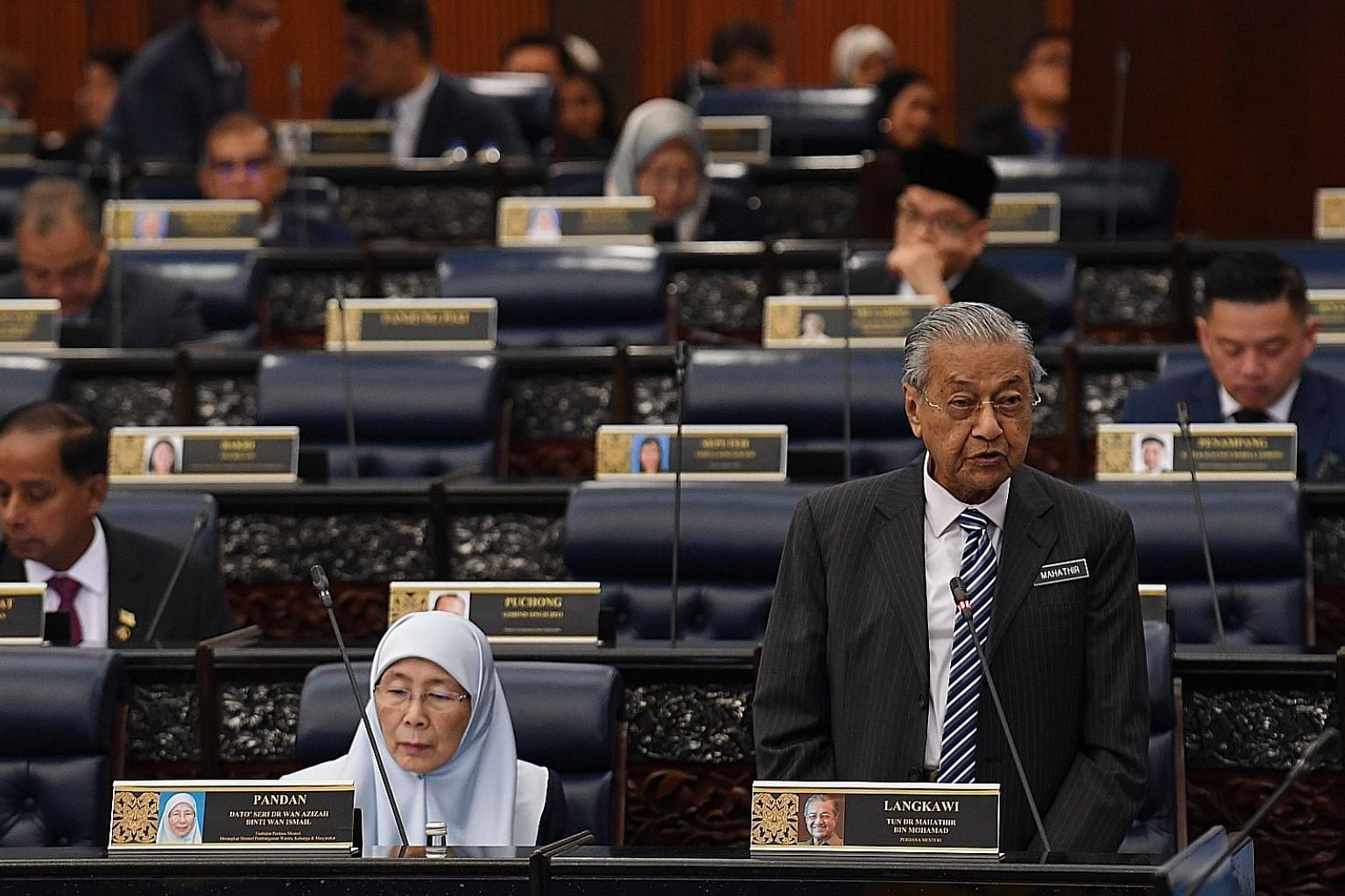 Malaysian Prime Minister Mahathir Mohamad speaking at a Parliament session yesterday, with Deputy Prime Minister Wan Azizah Wan Ismail seated next to him. PHOTO: BERNAMA