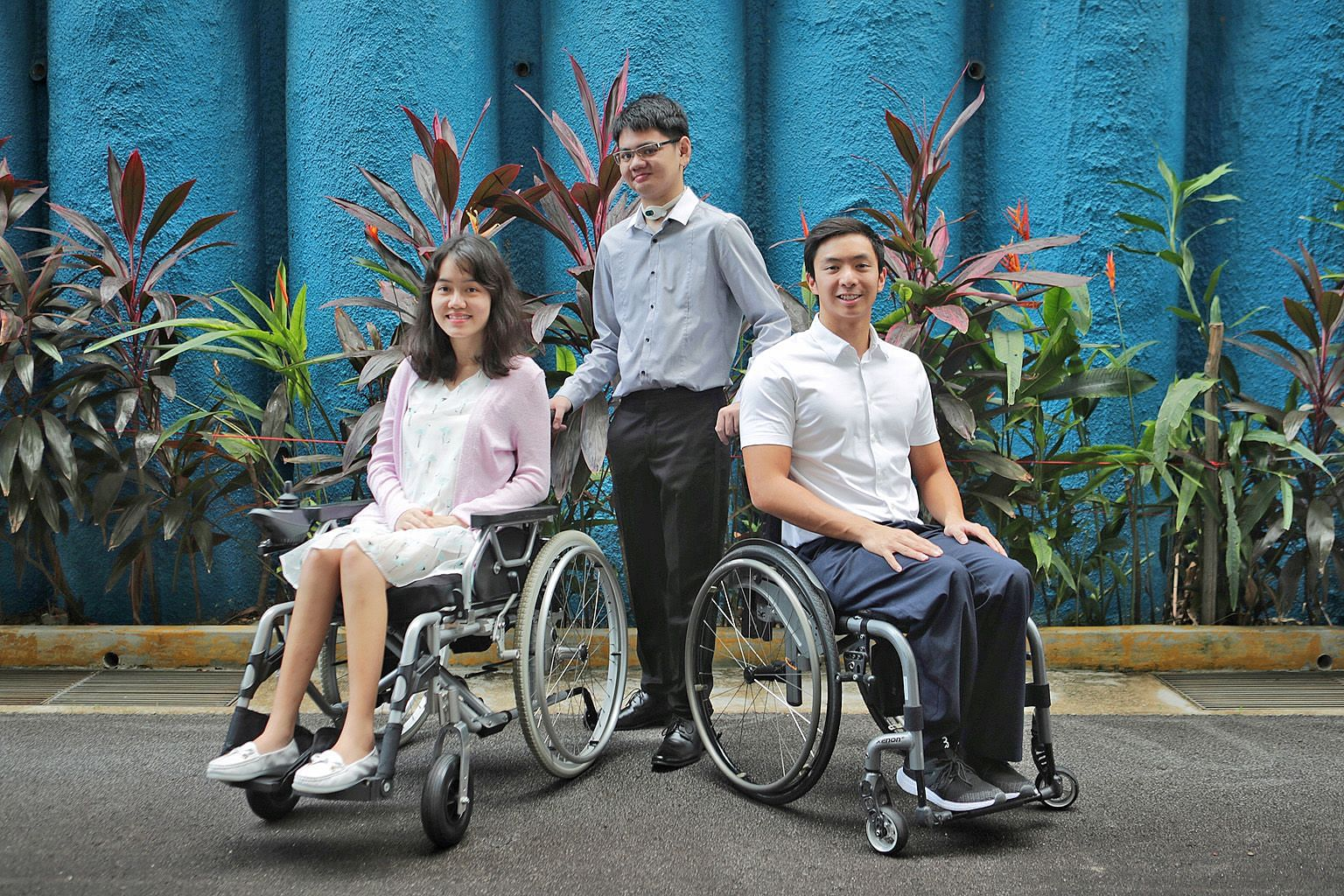 Mr Samuel Lim, flanked by Ms Foo Xu Hui and Mr Toh Wei Soong, breathes and eats through two tubes and has a speech impairment. The three students are among this year's four recipients of the Asia Pacific Breweries Foundation Scholarship for Persons w