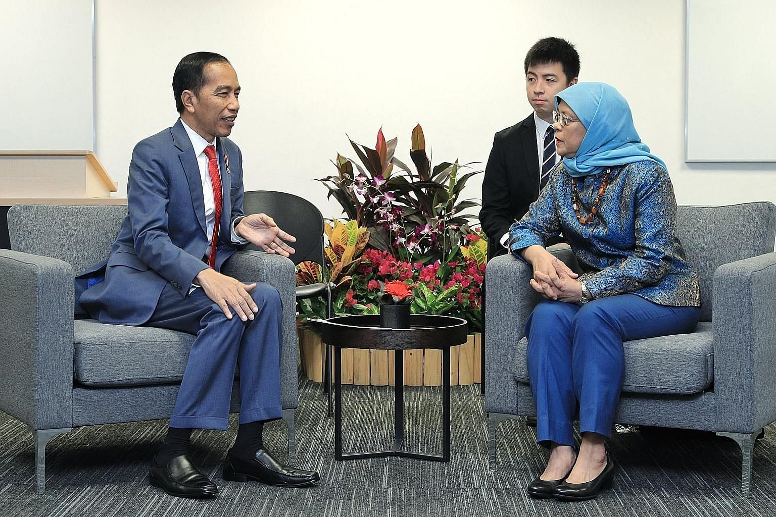 President Halimah Yacob meeting her Indonesian counterpart Joko Widodo at the Singapore University of Social Sciences yesterday. In a Facebook post, Madam Halimah said she congratulated Mr Joko on his son's graduation and entrepreneurship award, and