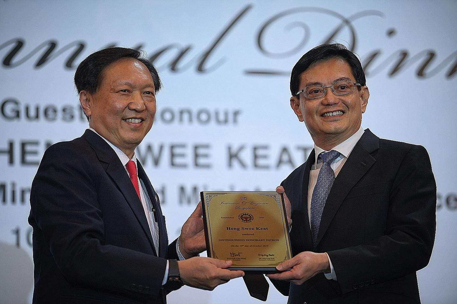 Deputy Prime Minister Heng Swee Keat being conferred the title of The Institution of Engineers, Singapore Distinguished Honorary Patron by IES president Yeoh Lean Weng yesterday.