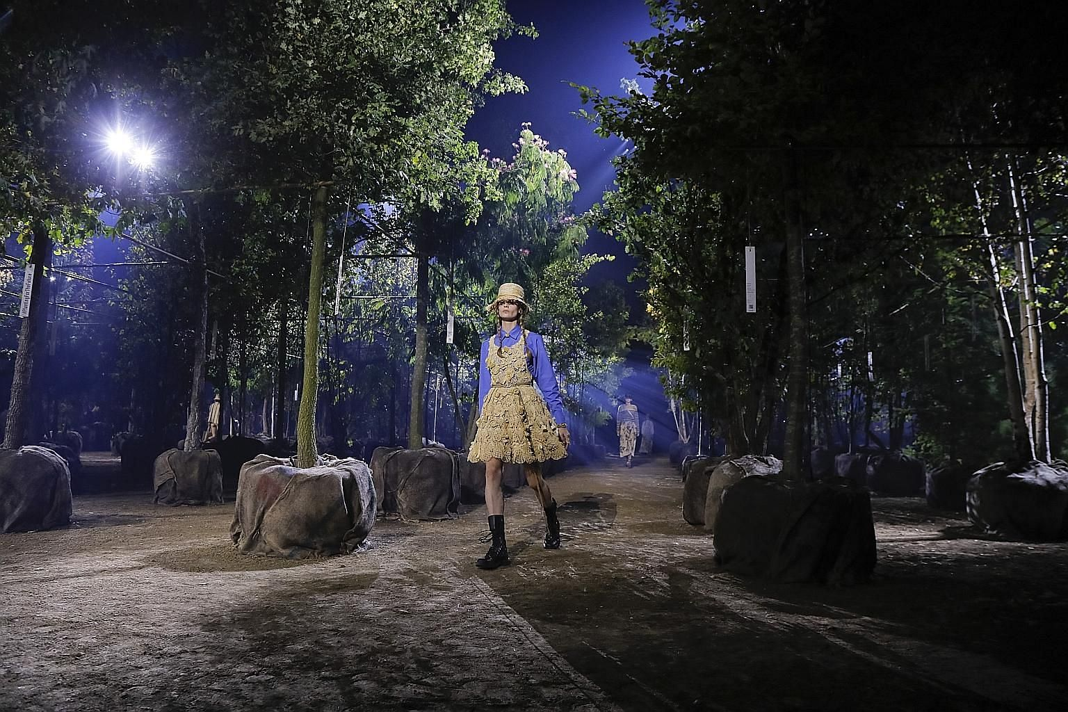 The Dior spring 2020 collection show in Paris on Sept 24 (above). The set was composed of more than 100 trees, all of which were bound for community gardens afterwards.