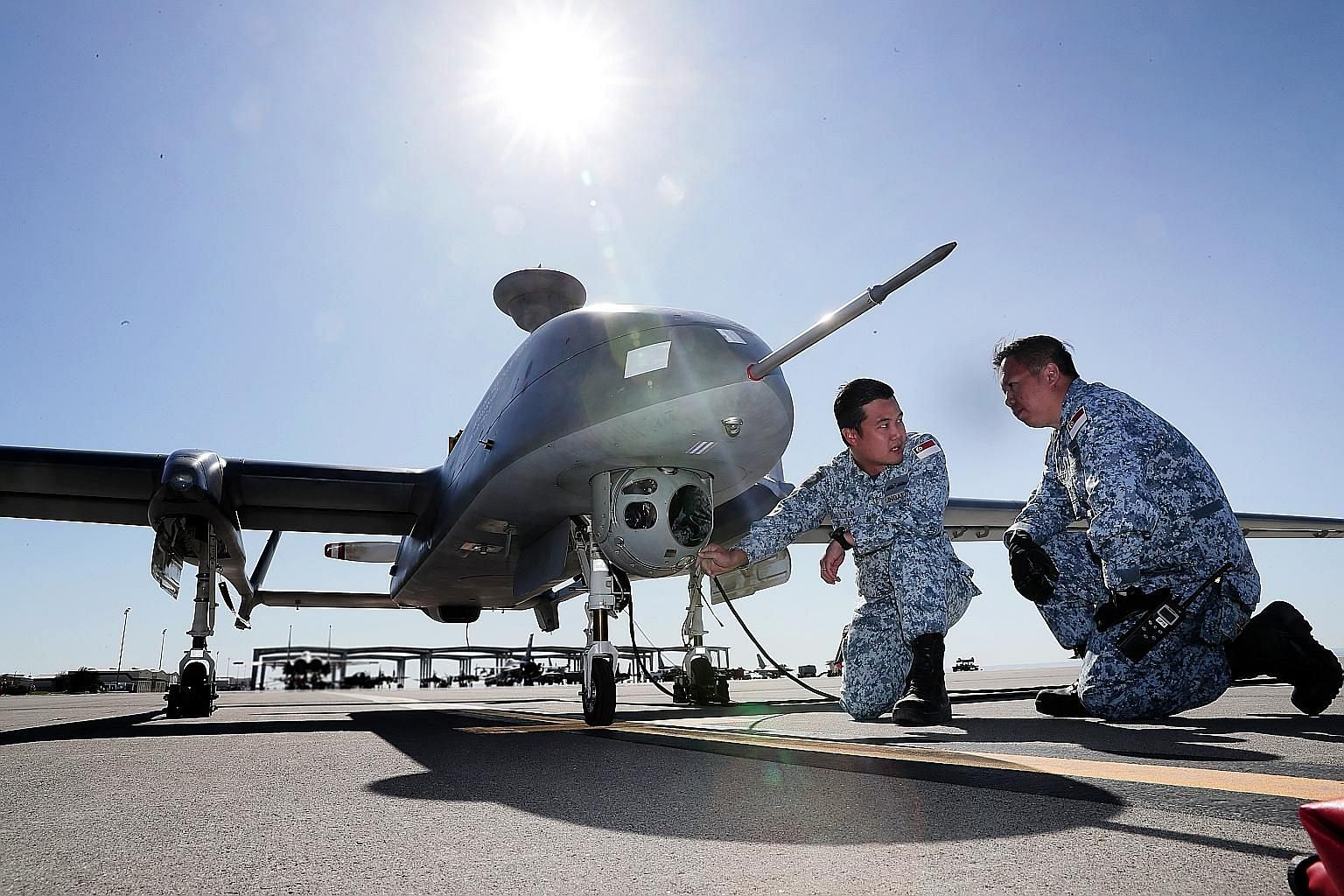 Pilot Tan Chin-I (left) and air force engineer The Jia Bao conducting checks on the Heron 1 unmanned aerial vehicle before a mission during Exercise Forging Sabre at the Mountain Home Air Force Base in the US state of Idaho on Monday. The exercise, i