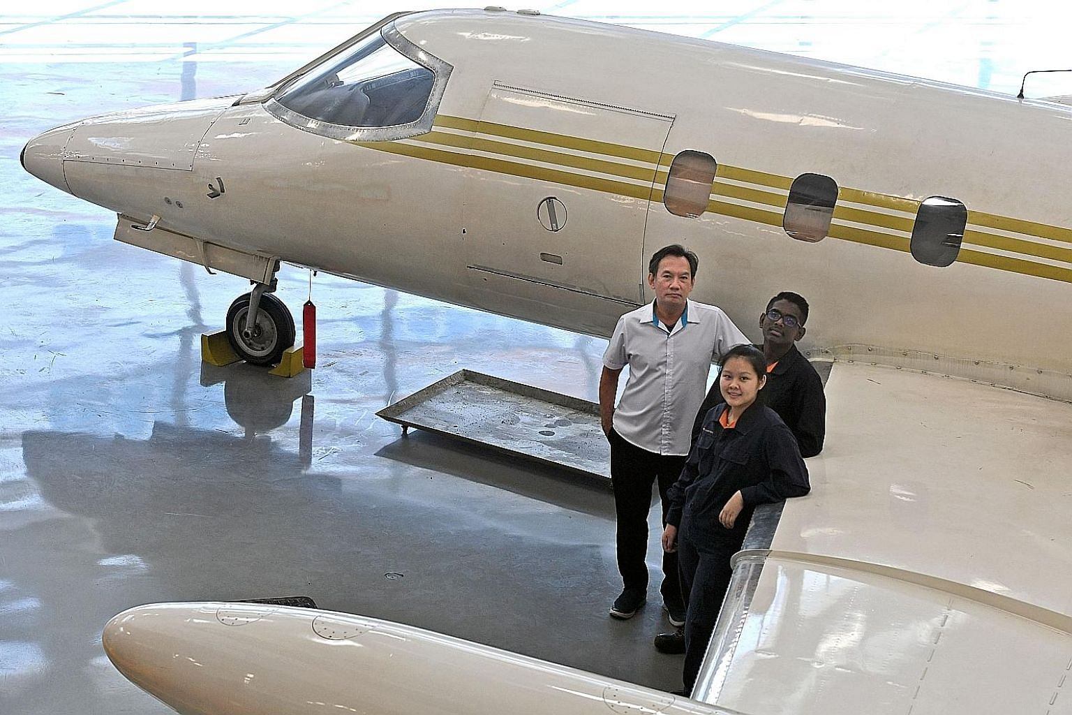 A team comprising ITE College Central students Michael Cham, 57, Nicole Ng, 17, and Steven Muthukumar, 17, won the top prize in the prototypes category of the Aviation Innovation Competition organised by the International Civil Aviation Organisation,