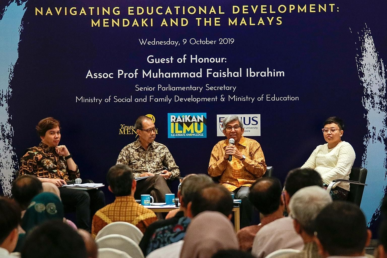 (From left) Dr Azhar Ibrahim, who moderated the dialogue, with Associate Professor Mukhlis Abu Bakar, Professor Yaacob Ibrahim and Ms Siti Hazirah Mohamad. They were speaking at a dialogue on self-help group Yayasan Mendaki's latest book (above). PHO
