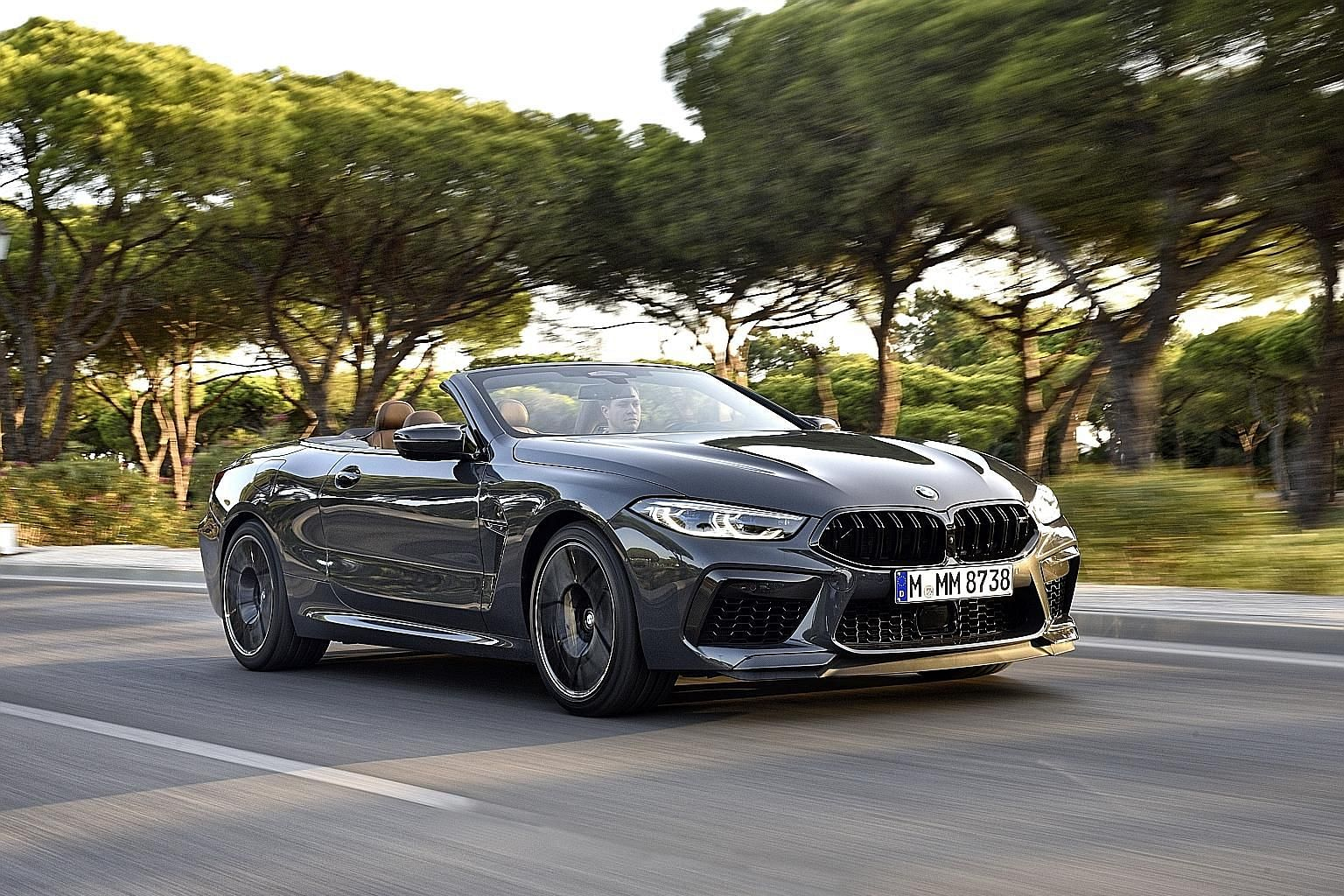 The BMW M8 Competition Convertible (above) sprints to 100kmh in 3.3 seconds, while the Coupe does it in 3.2 seconds.