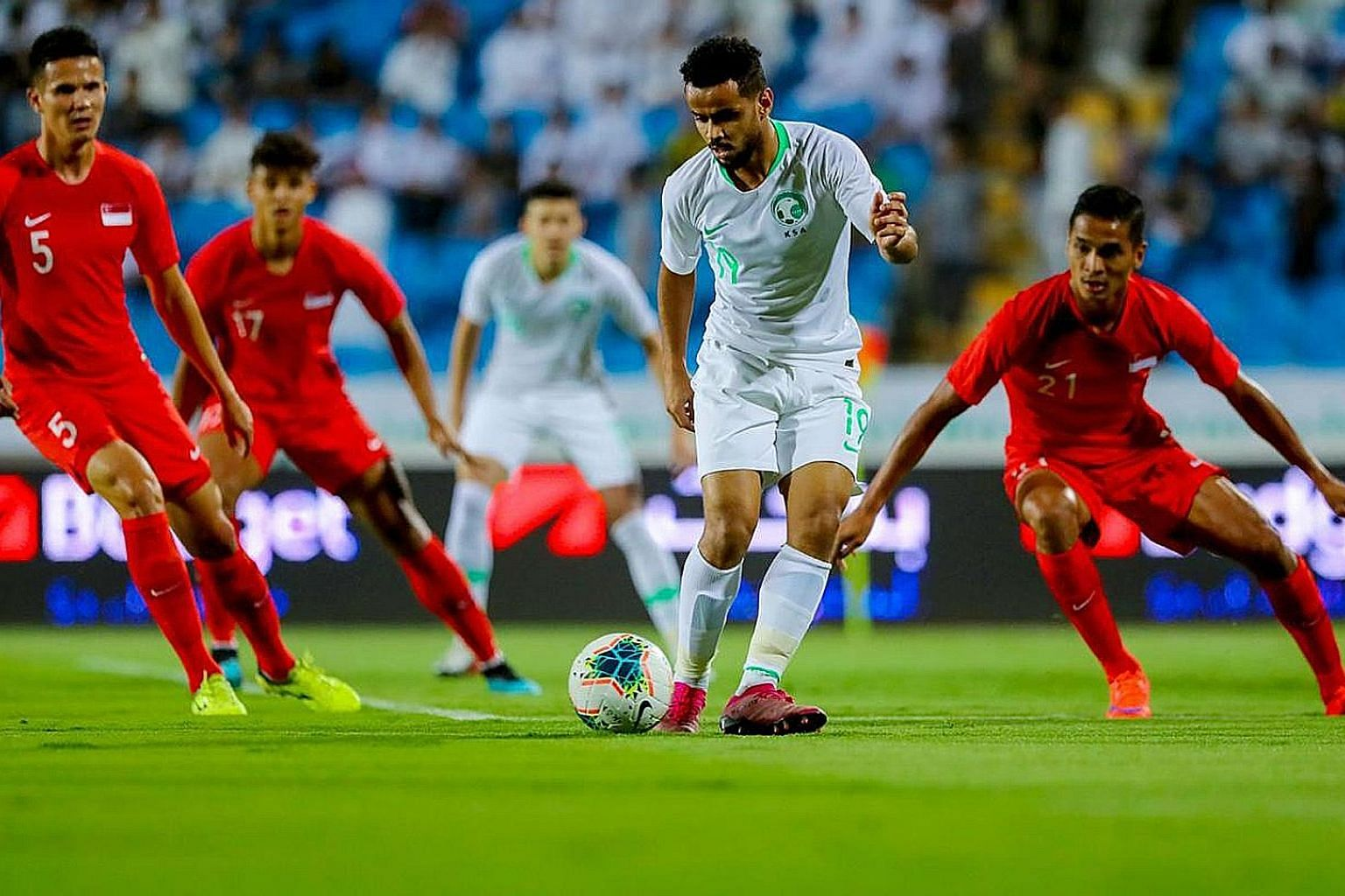 The Singapore defence finding Saudi Arabia forward Abdulfattah Asiri a hard man to contain. He scored a brace in the hosts' 3-0 win in the World Cup qualifier in Buraidah on Thursday night. PHOTO: SAUDI ARABIAN FOOTBALL FEDERATION