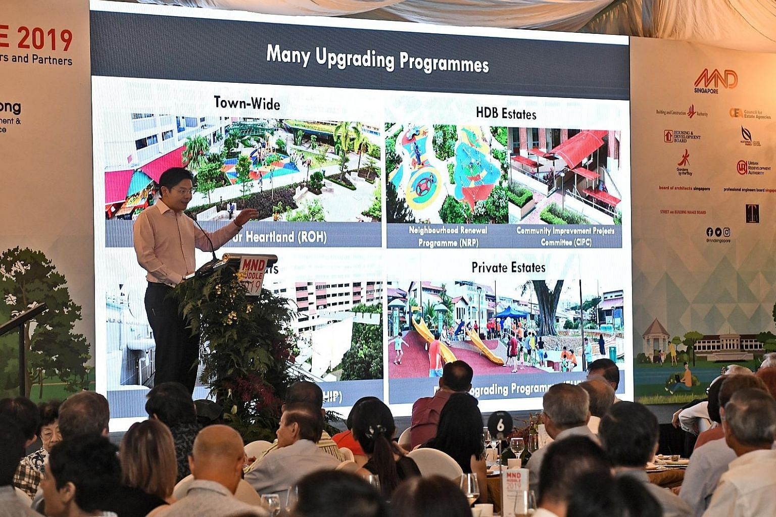 """National Development Minister Lawrence Wong speaking at the annual MND Huddle yesterday at Fort Canning Park. He said the upgrading projects would also offer """"a healthy pipeline of public sector projects"""", providing opportunities for consultants and"""