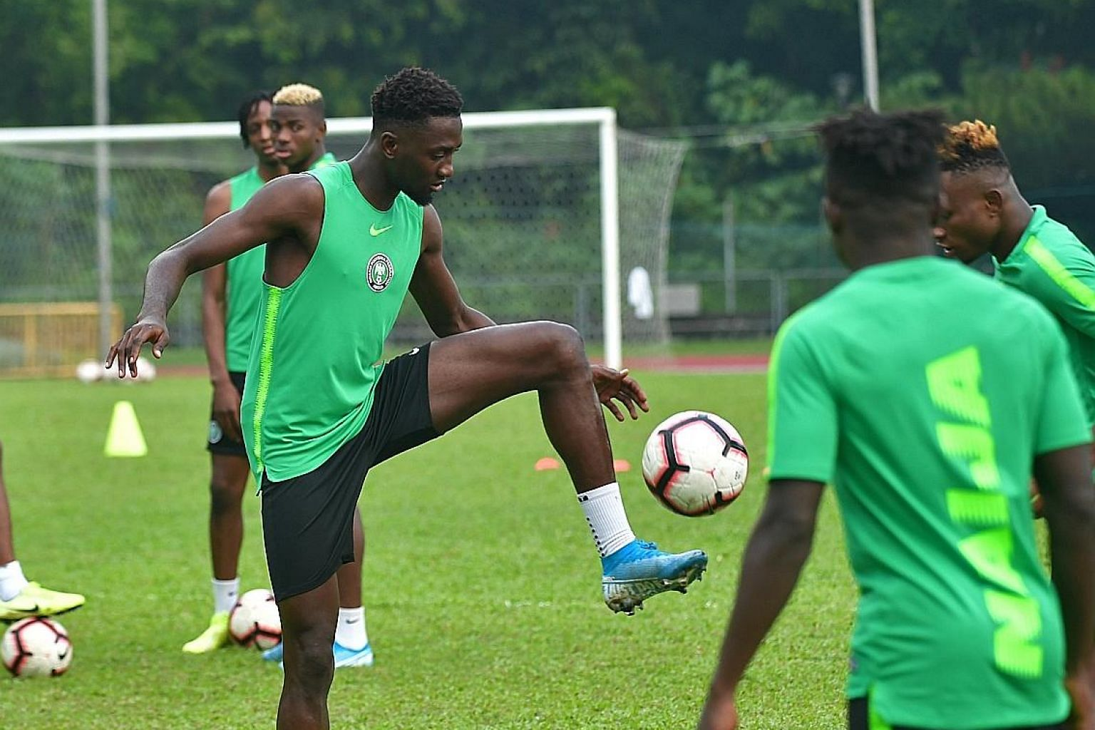 Wilfred Ndidi training with the Nigeria football team at Bukit Gombak Stadium yesterday for their friendly against Brazil tonight. ST PHOTO: DESMOND WEE
