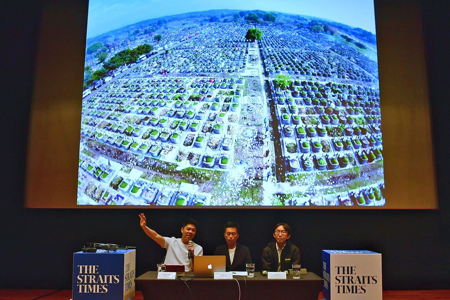 Straits Times photojournalists (from left) Benjamin Seetor, Ong Wee Jin and Lim Yaohui giving a talk on drone photography at the National Museum of Singapore yesterday.