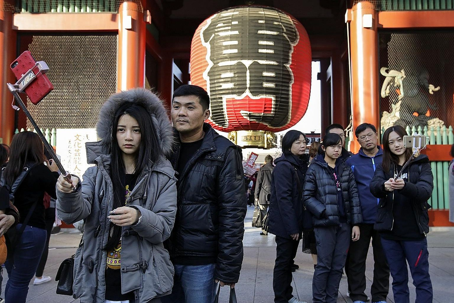 Tourists from China taking wefies in front of a huge paper lantern at the Kaminarimon Gate of Sensoji temple in Asakusa, Tokyo. Chinese nationals made 8.4 million trips to Japan last year, up 13.9 per cent from 2017, according to the Japan National T