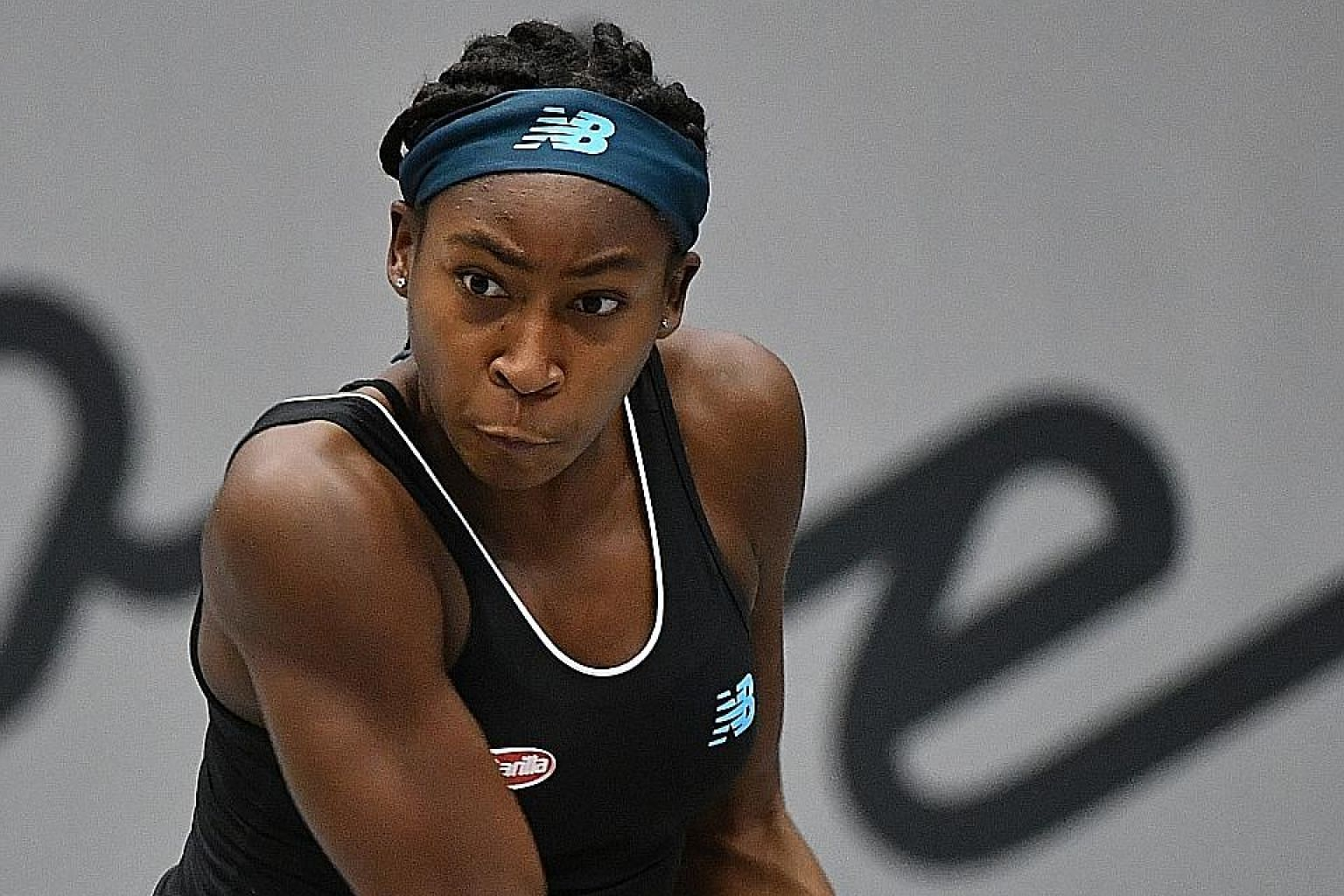 Teenage prodigy Coco Gauff on the way to claiming her first WTA title with a 6-3, 1-6, 6-2 victory over former French Open champion Jelena Ostapenko in Linz yesterday. PHOTO: DPA