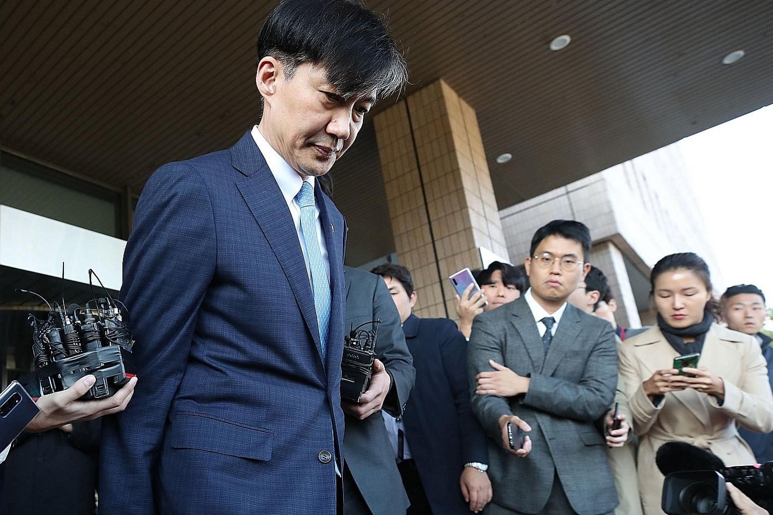 South Korean justice minister Cho Kuk leaving the ministry in Gwacheon, south of Seoul, yesterday. The 54-year-old quit as a scandal swirled over academic privileges allegedly given to his children.