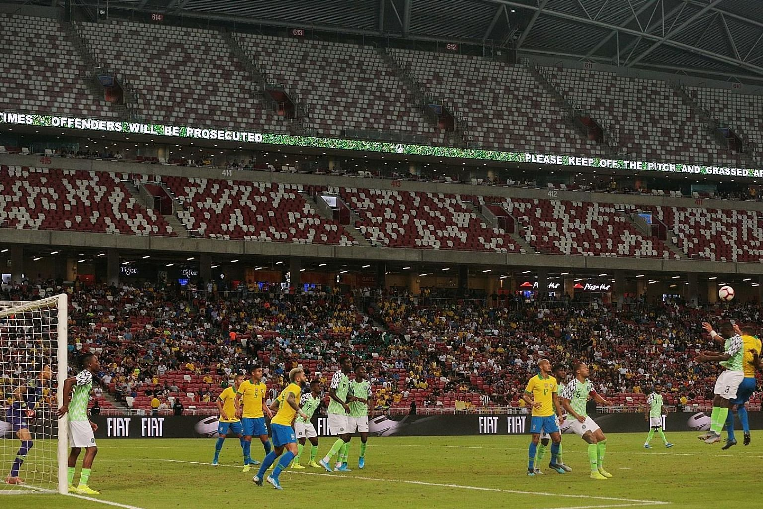 The higher tiers of the 55,000-capacity National Stadium were empty for last Sunday's Brazil v Nigeria friendly game (above) and also last Thursday's Brazil v Senegal match. ST PHOTO: JASON QUAH