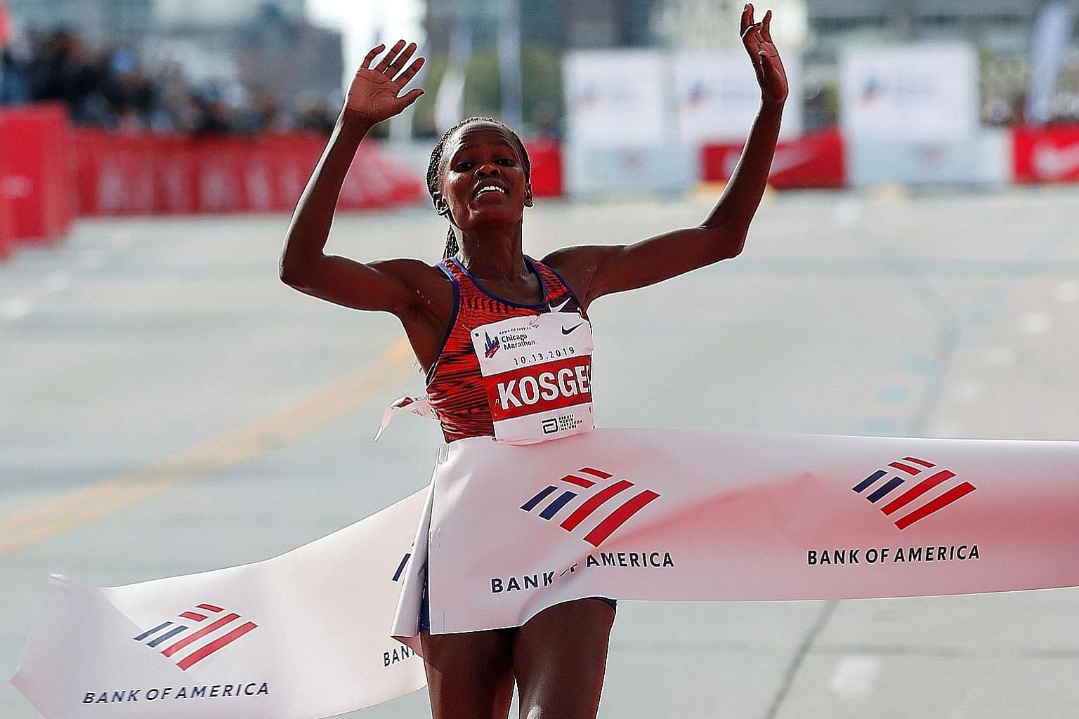 Brigid Kosgei crosses the Chicago Marathon finish line in 2:14:04 to smash Paula Radcliffe's world mark by a whopping 1:21. PHOTO: REUTERS