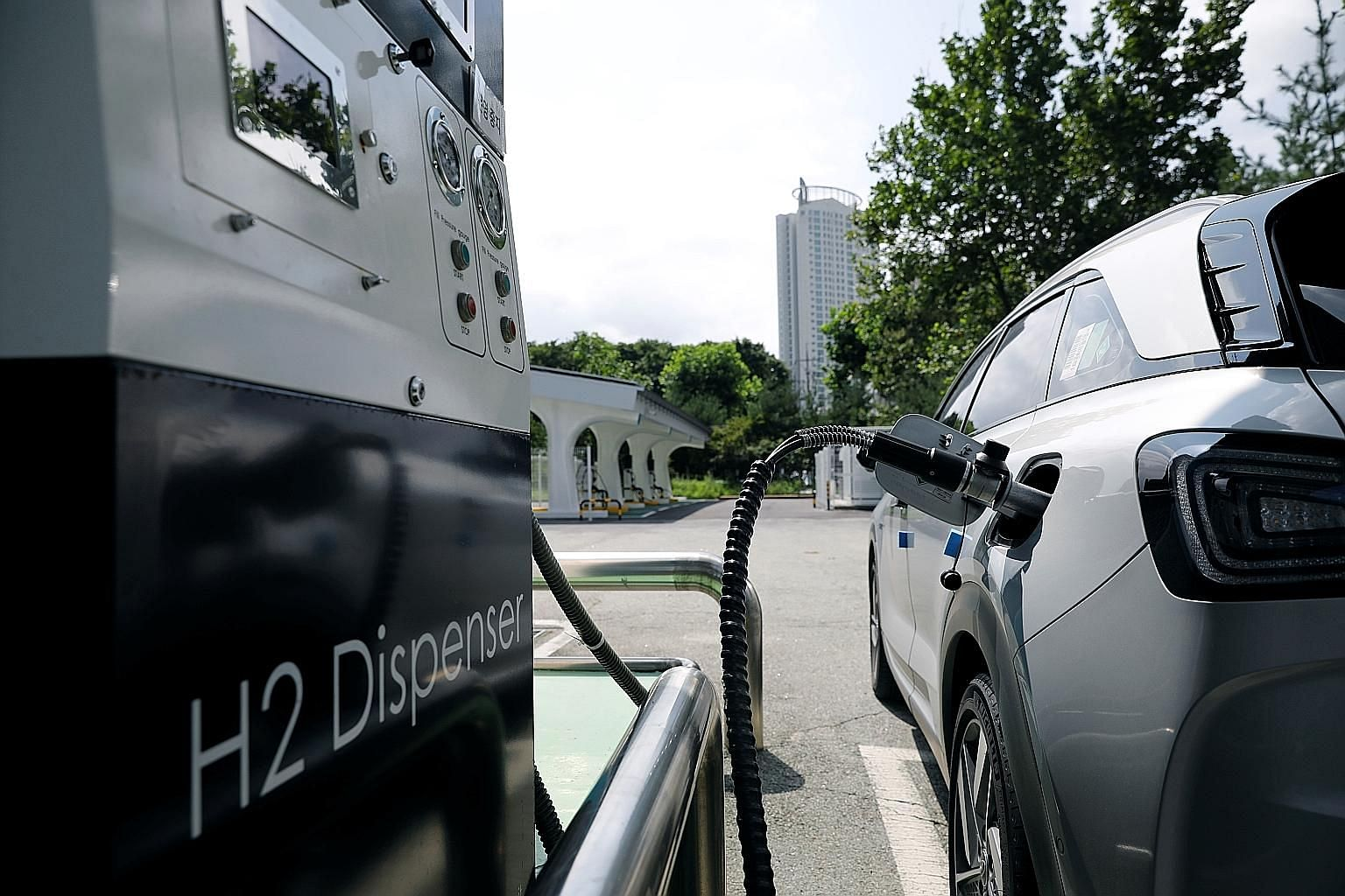 A Nexo hydrogen car from Hyundai being refuelled in Seoul. South Korea's President Moon Jae-in said the country's firms will invest $69 billion over the next decade in the future of transportation.