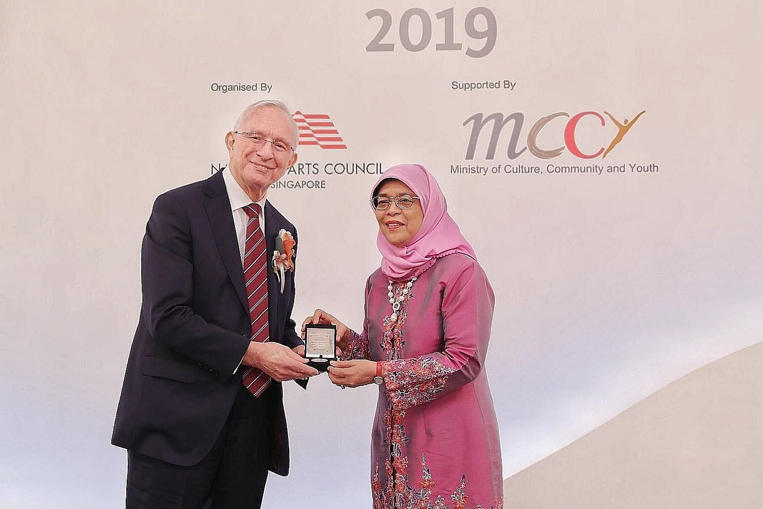 Composer Eric James Watson receiving the Cultural Medallion from President Halimah Yacob at the Istana yesterday. Mr Watson is the 126th artist to be given the Cultural Medallion, which comes with $80,000 from the Cultural Medallion Fund that recipie