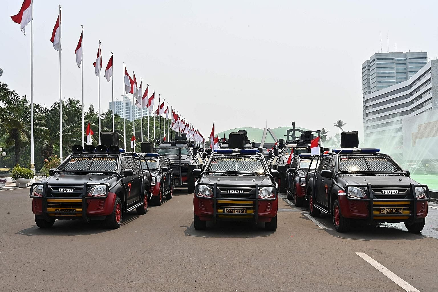 Armoured vehicles stationed in Jakarta ahead of the presidential inauguration on Sunday. The swearing-in of incumbent Indonesian President Joko Widodo will be conducted at the Parliament building in the capital, witnessed by a number of foreign leade