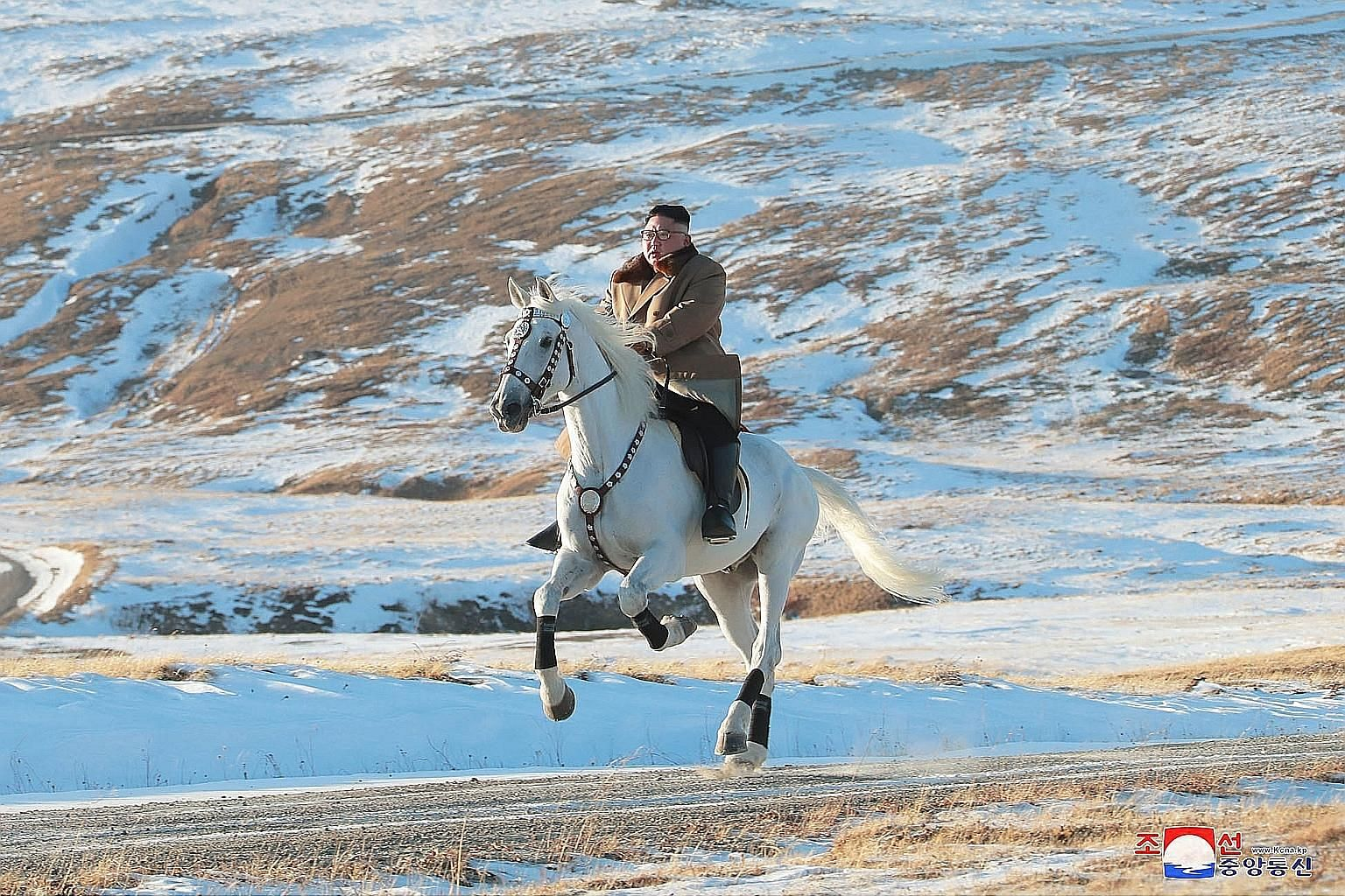 This undated photo provided by state news agency KCNA yesterday shows North Korean leader Kim Jong Un riding a white horse on the snow-covered Mount Paektu, the spiritual homeland of the Kim dynasty. Mr Kim has often made trips to the sacred mountain
