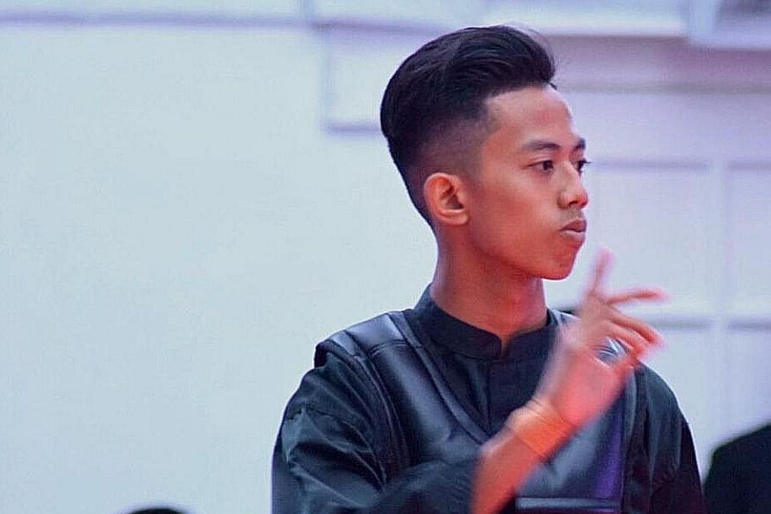Hazim Yusli at the South-east Asian Sultan's Pencak Silat Championship this week. The 17-year-old had to settle for the silver after withdrawing from the Class B final. Singapore ended second on the medal tally with two golds, six silvers and two bro