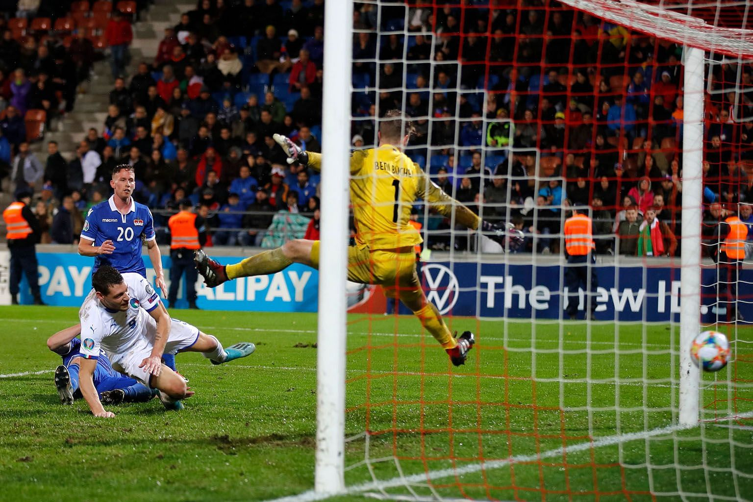 Italy's Andrea Belotti (in white) heading in one of his two goals in the 5-0 Euro 2020 qualifying win over Liechtenstein on Tuesday. It was the Italians' ninth win in a row, having won all eight of their qualifiers. PHOTO: AGENCE FRANCE-PRESSE