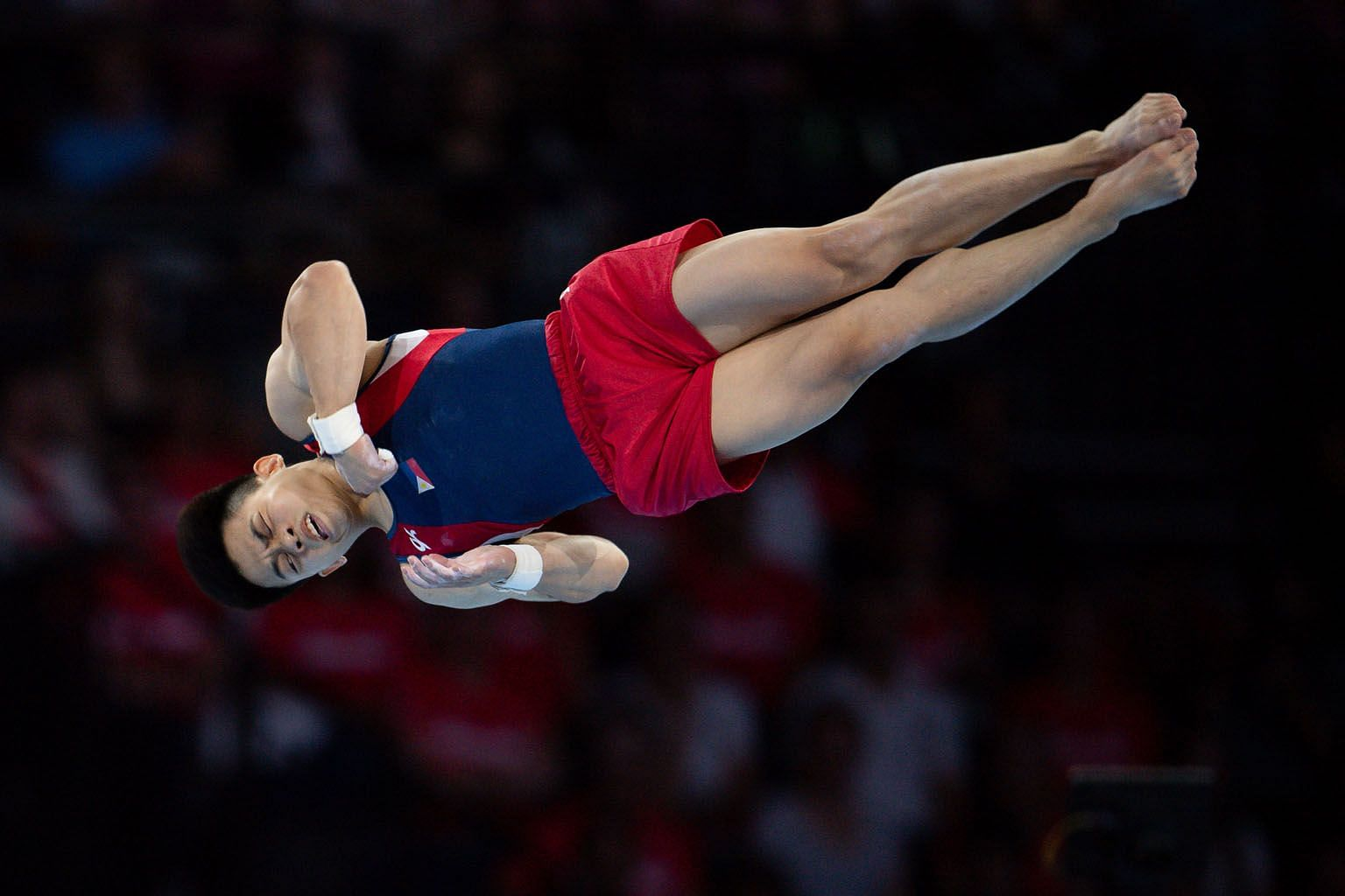 Carlos Yulo of the Philippines twisting to the floor exercise title at the Gymnastics World Championships in Stuttgart last Saturday. PHOTO: EPA-EFE