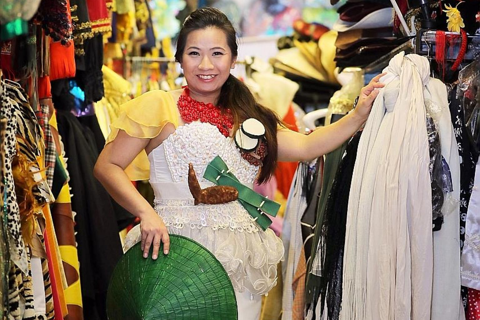 Theresa Chan (left, at her costume shop in MacPherson Road), worked her way up from dresser to wardrobe manager to costume designer.