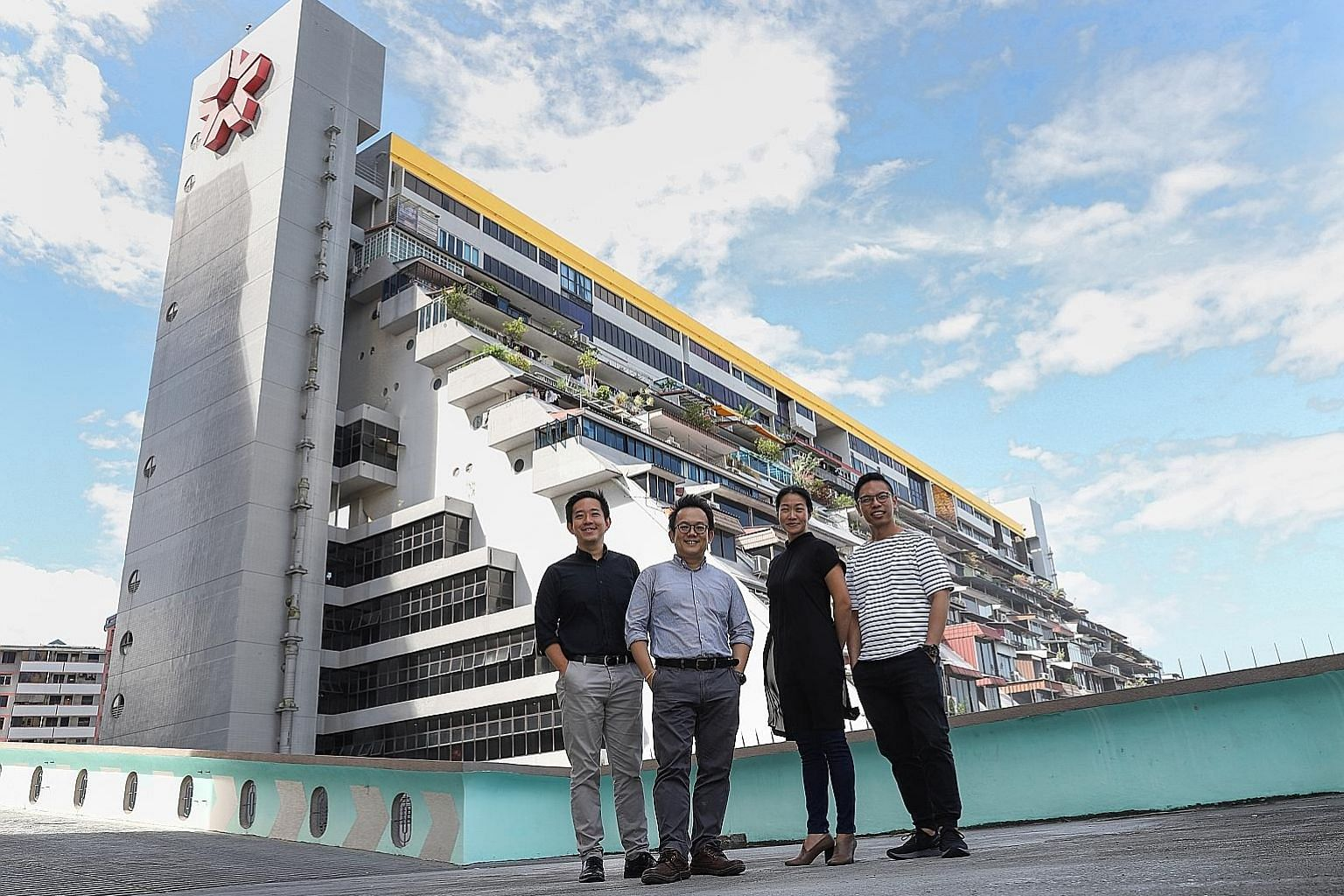 (From left) Engineer Colin Yip, conservation expert Ho Weng Hin, consultant Karen Tan and architect Jonathan Poh at the carpark of Golden Mile Tower, with Golden Mile Complex in the background. They are part of a group that is compiling the list of 5