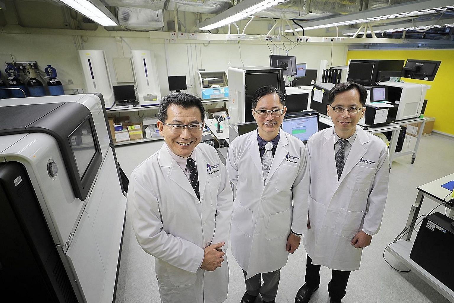 (From left) Prof Liu Jianjun, deputy executive director and senior group leader (human genetics) at the Genome Institute of Singapore (GIS); Prof Patrick Tan, GIS executive director; and Prof Cheng Ching-Yu, principal clinician scientist at the Singa