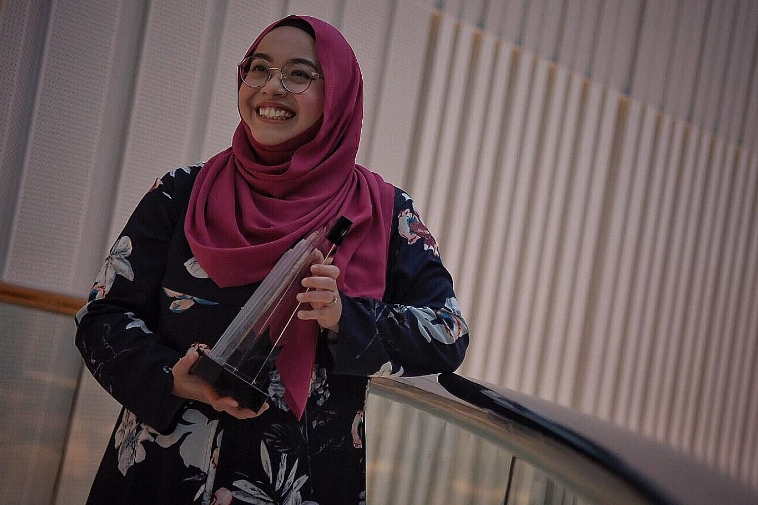 SMRT fleets and assets supervisor Ulfah Khairiah Aman yesterday received the National Service Advocate Award, the highest accolade for those who have gone the extra mile to support Singapore's defence.